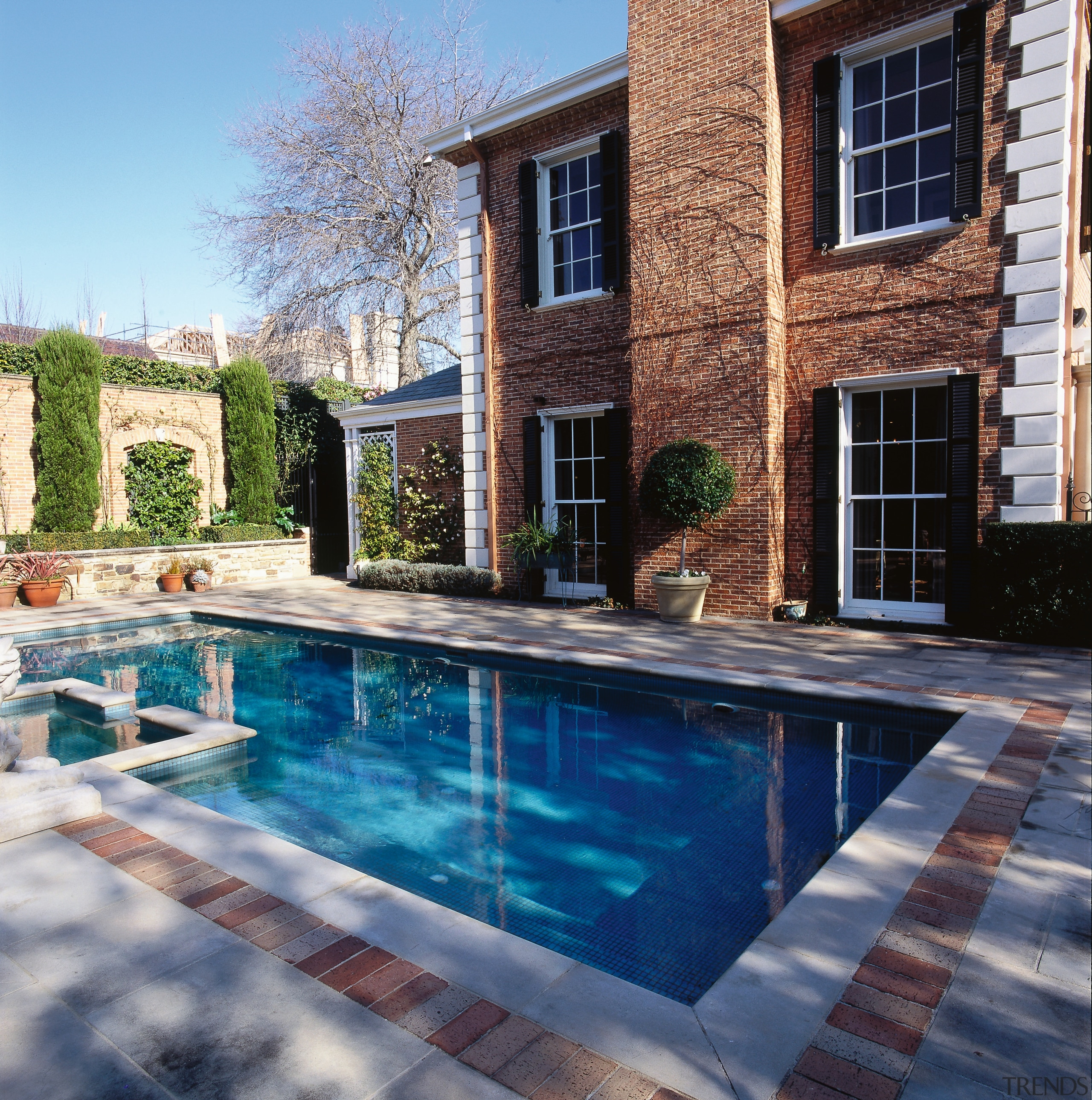 View of the pool and patio area, brick backyard, estate, home, house, outdoor structure, patio, property, real estate, reflection, swimming pool, water, window