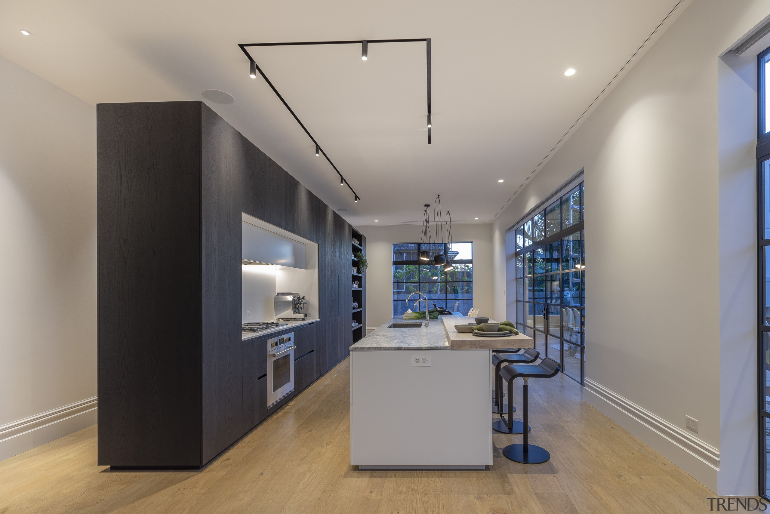 Strong, clean lines were appropriate for the new architecture, building, ceiling, daylighting, design, floor, flooring, furniture, glass, hardwood, home, house, interior design, light fixture, lighting, office, property, real estate, room, space, table, wall, wood flooring, gray