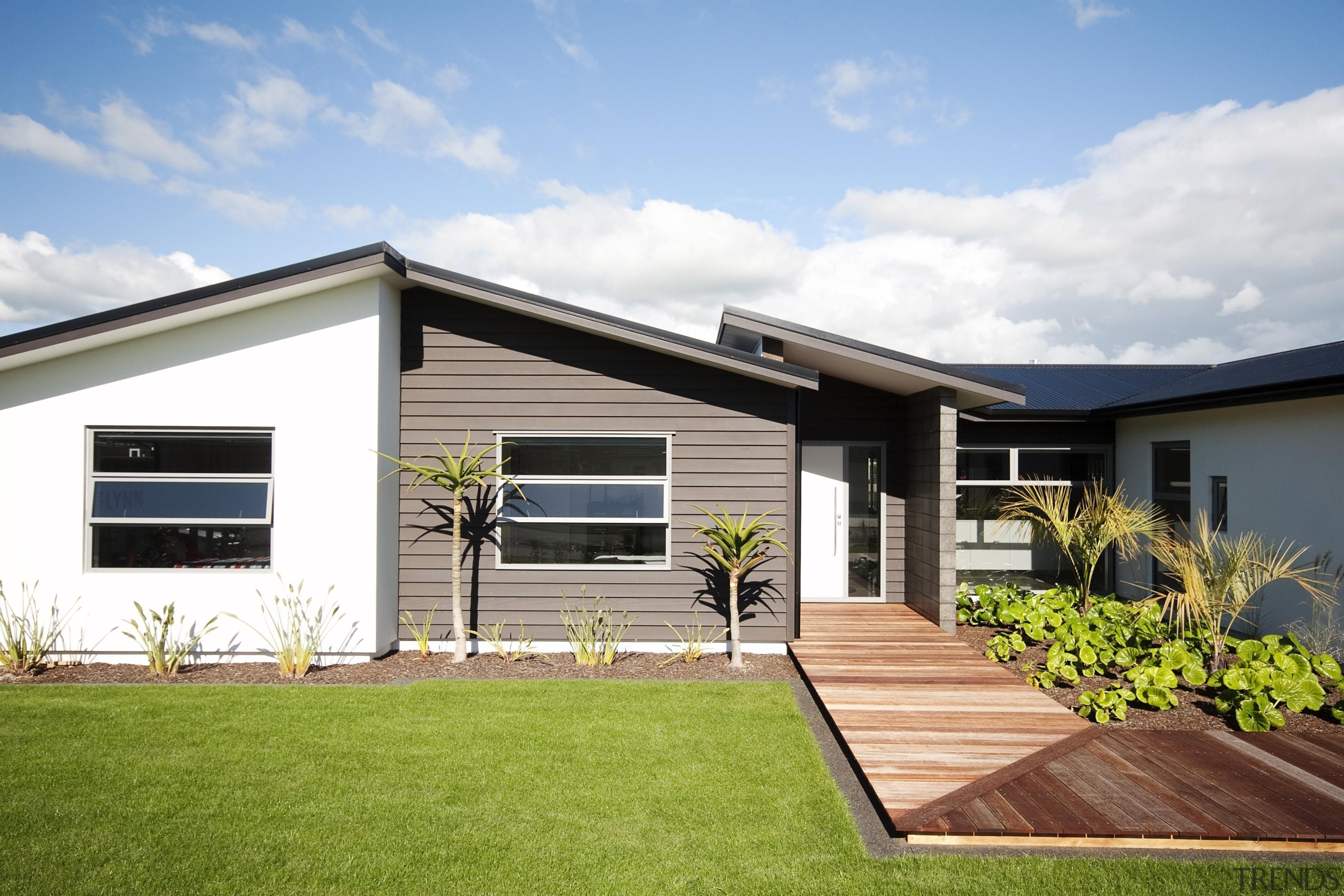 Popular mix of materials in this home built architecture, backyard, cottage, elevation, estate, facade, home, house, property, real estate, residential area, siding, window, yard, white