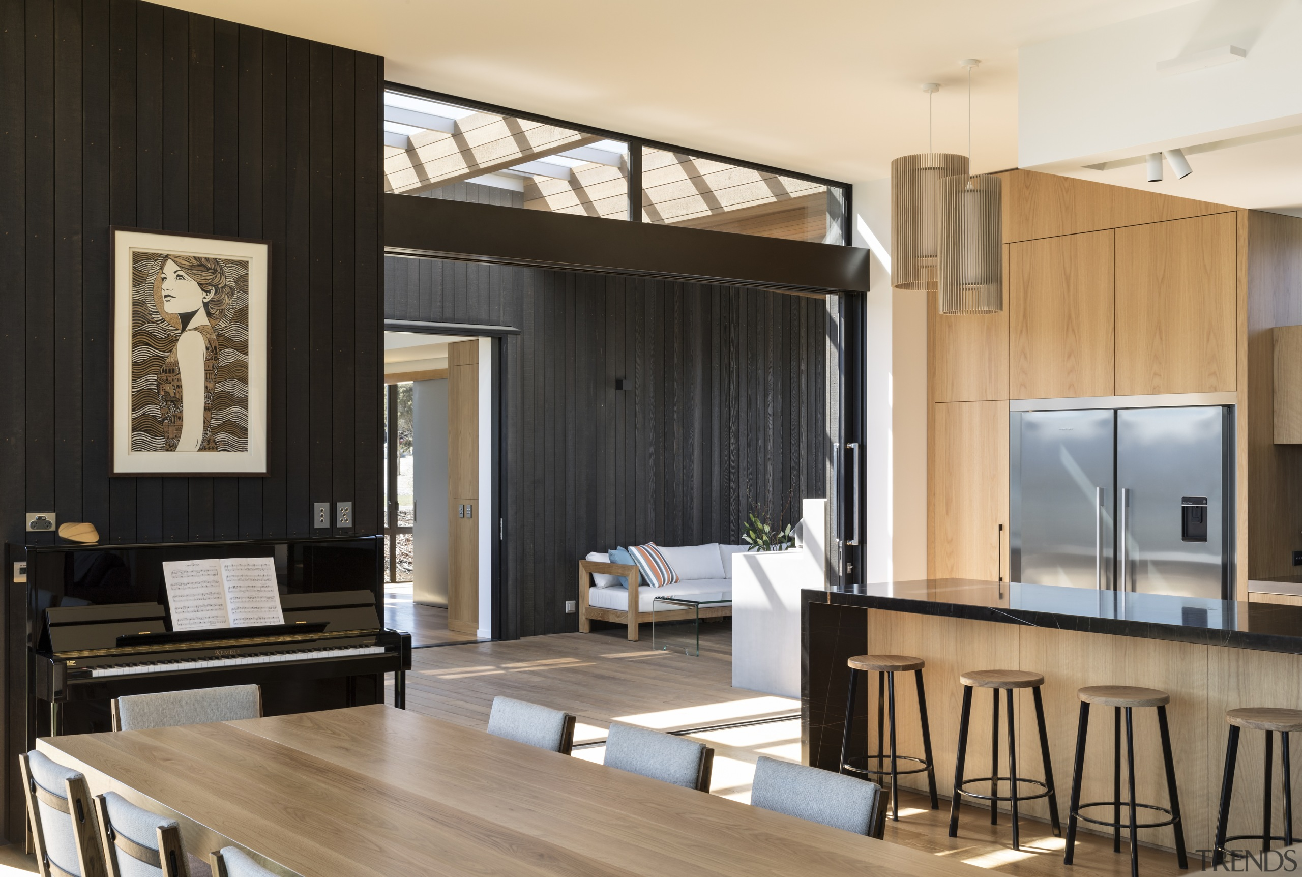 ​​​​​​​The play of wood and black is seen architecture, building, design, dining room, floor, flooring, furniture, hardwood, home, house, interior design, living room, loft, table, wood flooring, black, Eliska Lewis Architects