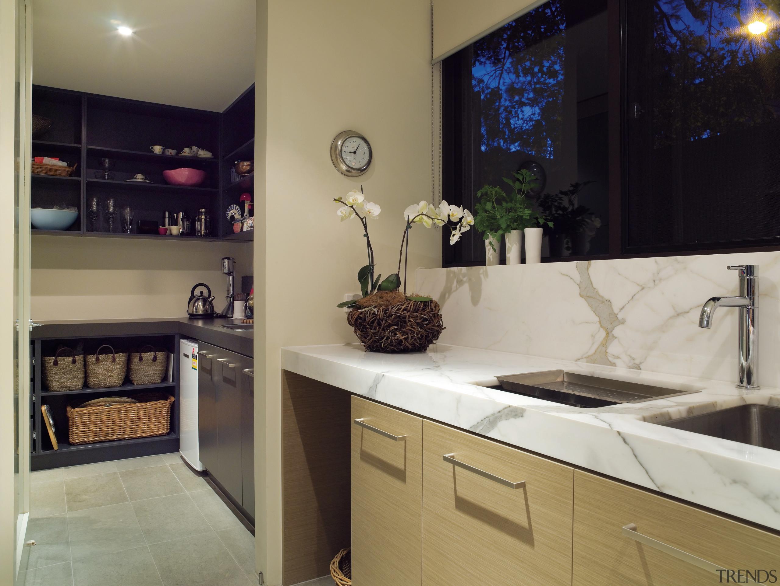 A view of this kitchen featuring clalcutta marble countertop, interior design, kitchen, room, gray, black