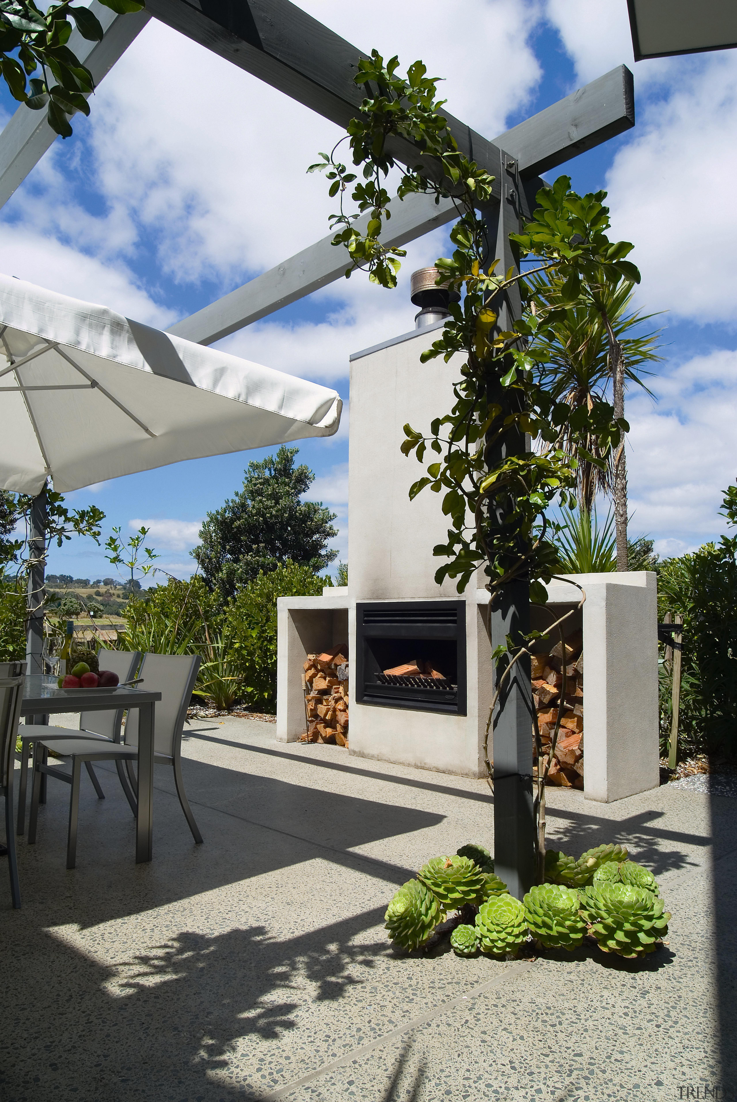 View of the precast fireplace  and exposed architecture, courtyard, home, house, outdoor structure, property, real estate, tree, gray, black