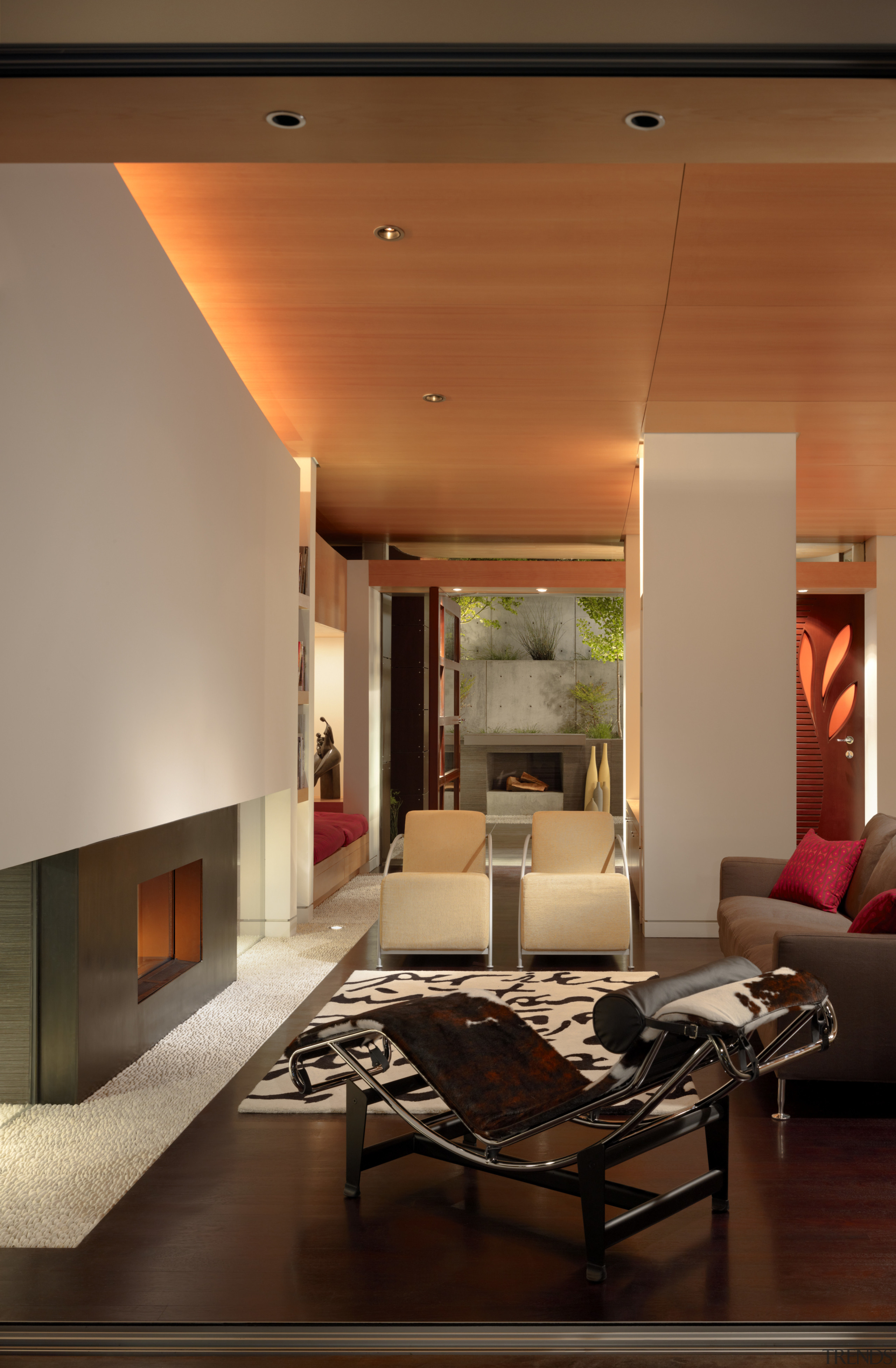 View of a living area with sofas, seating architecture, ceiling, floor, home, house, interior design, lighting, living room, lobby, room, table, wall, brown, orange