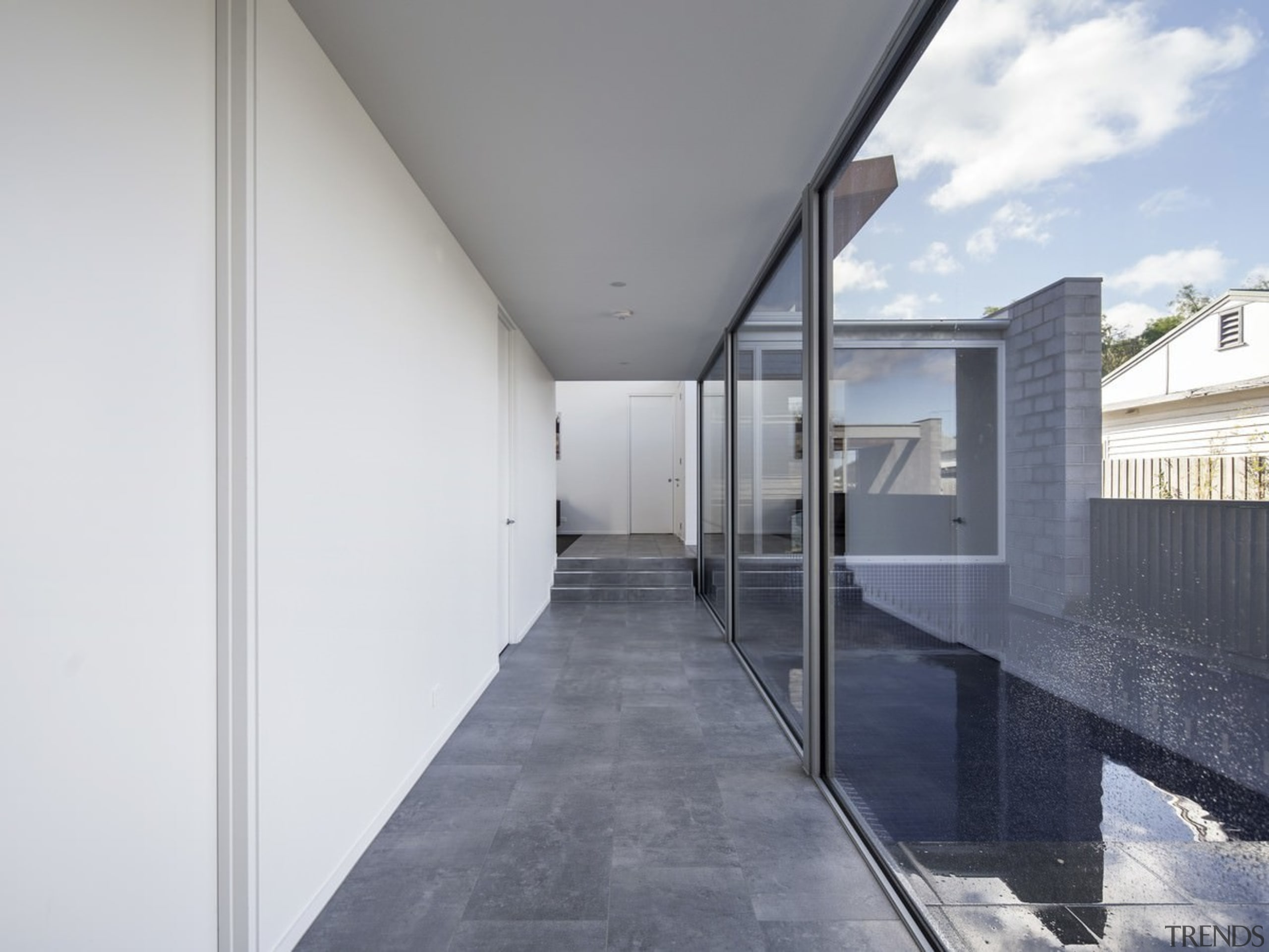 The hallway faces out to the swimming pool apartment, architecture, building, daylighting, facade, floor, glass, house, interior design, real estate, white, gray