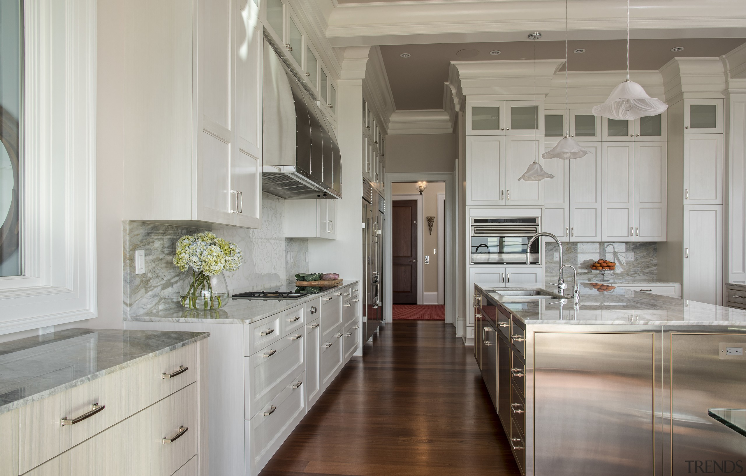 Stainless steel on this kitchens two islands is cabinetry, countertop, cuisine classique, floor, flooring, home, interior design, kitchen, room, gray