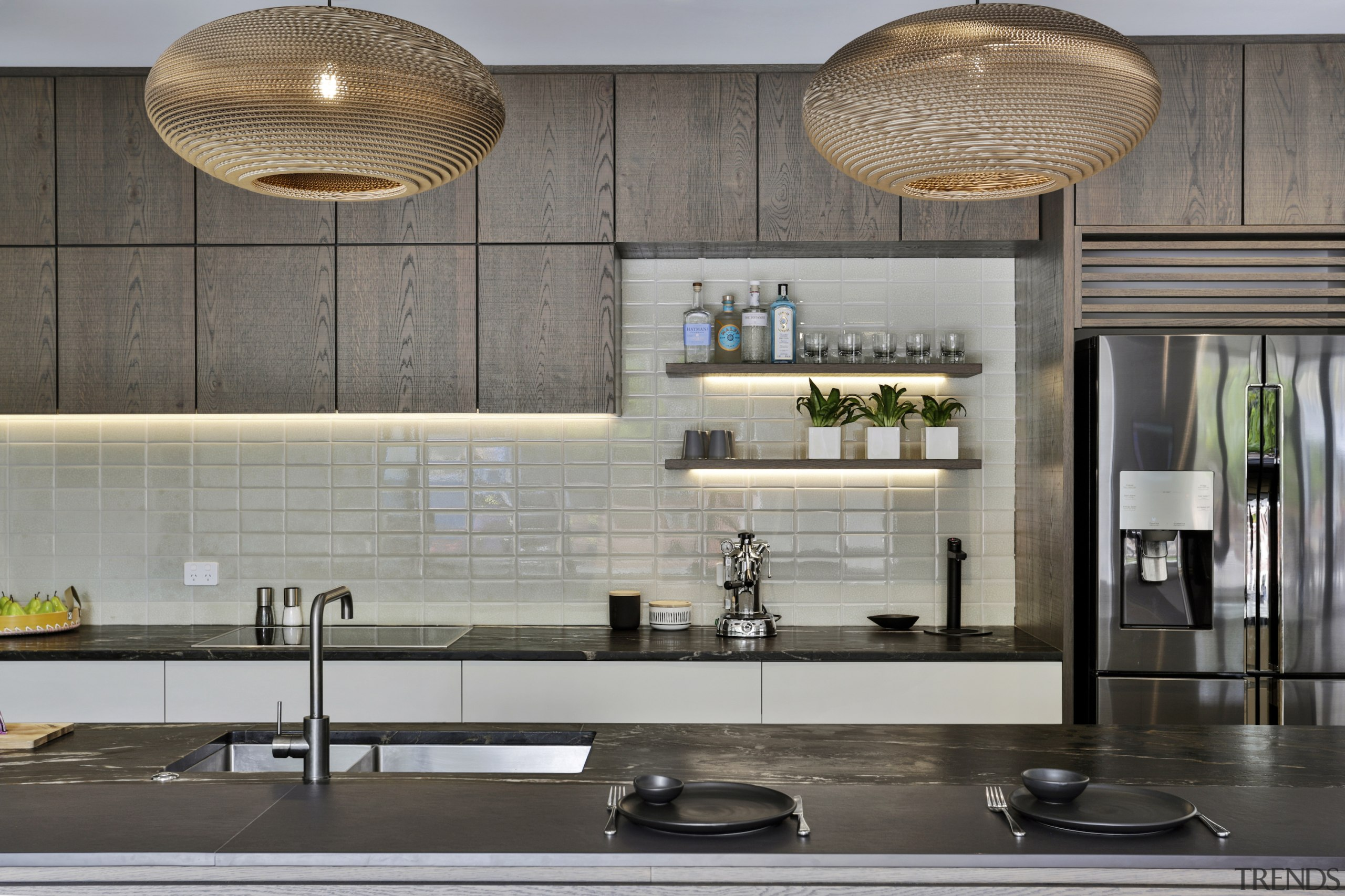 Both the crackle-glaze tiles and refrigerator reflect natural
