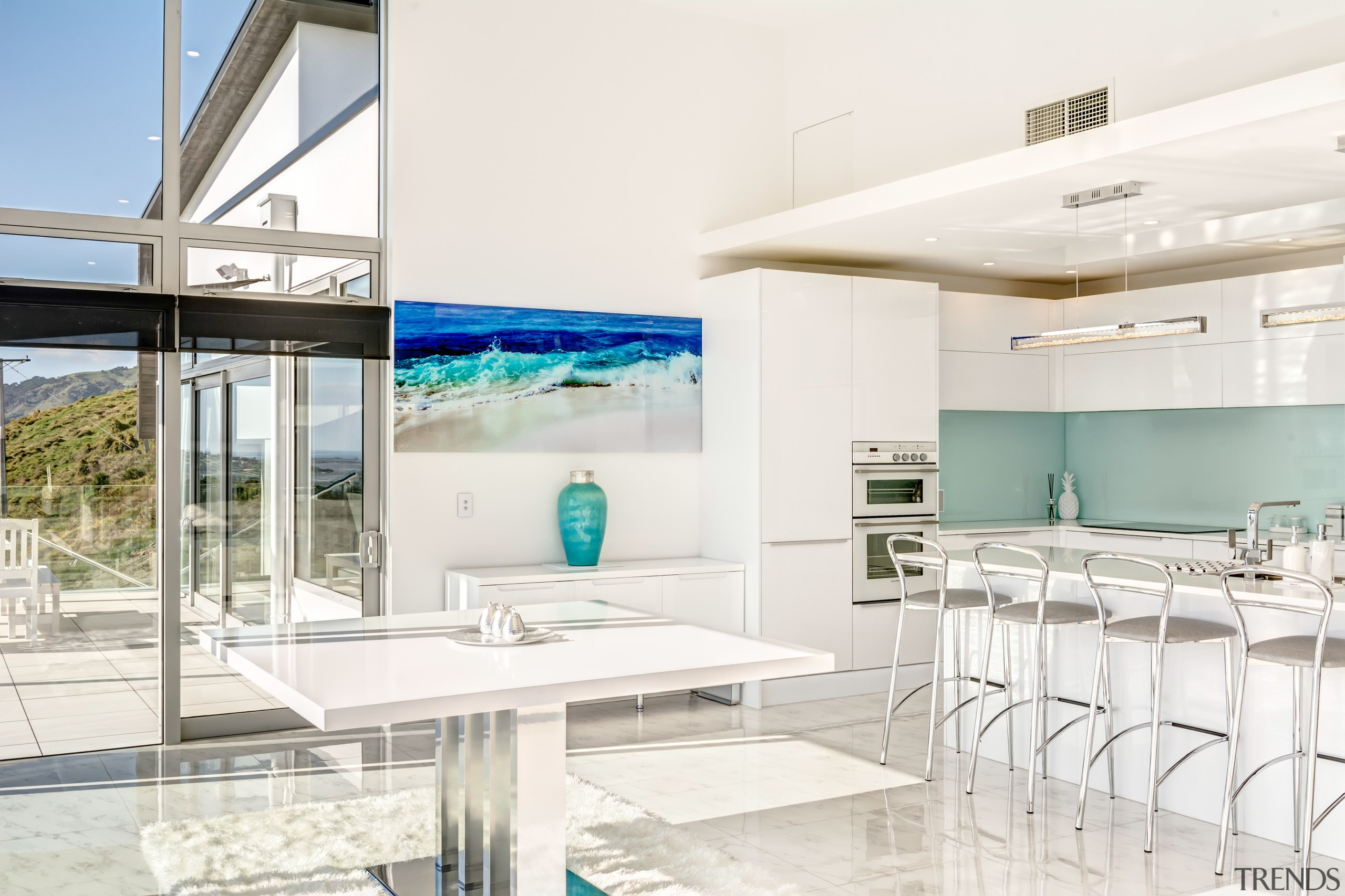 Glass and white surfaces predominate in this European-style architecture, house, interior design, real estate, white