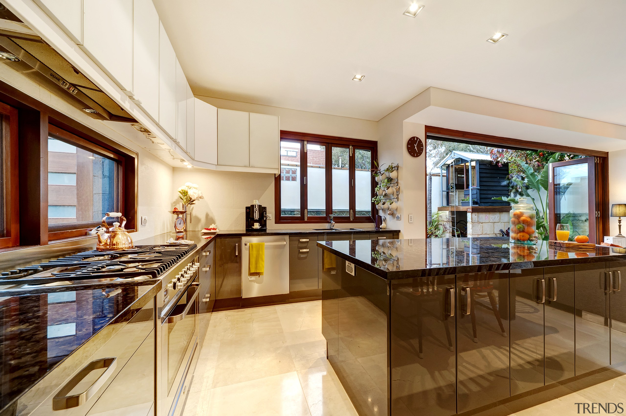 This kitchen wraps around two walls and includes ceiling, countertop, estate, home, interior design, kitchen, property, real estate, white