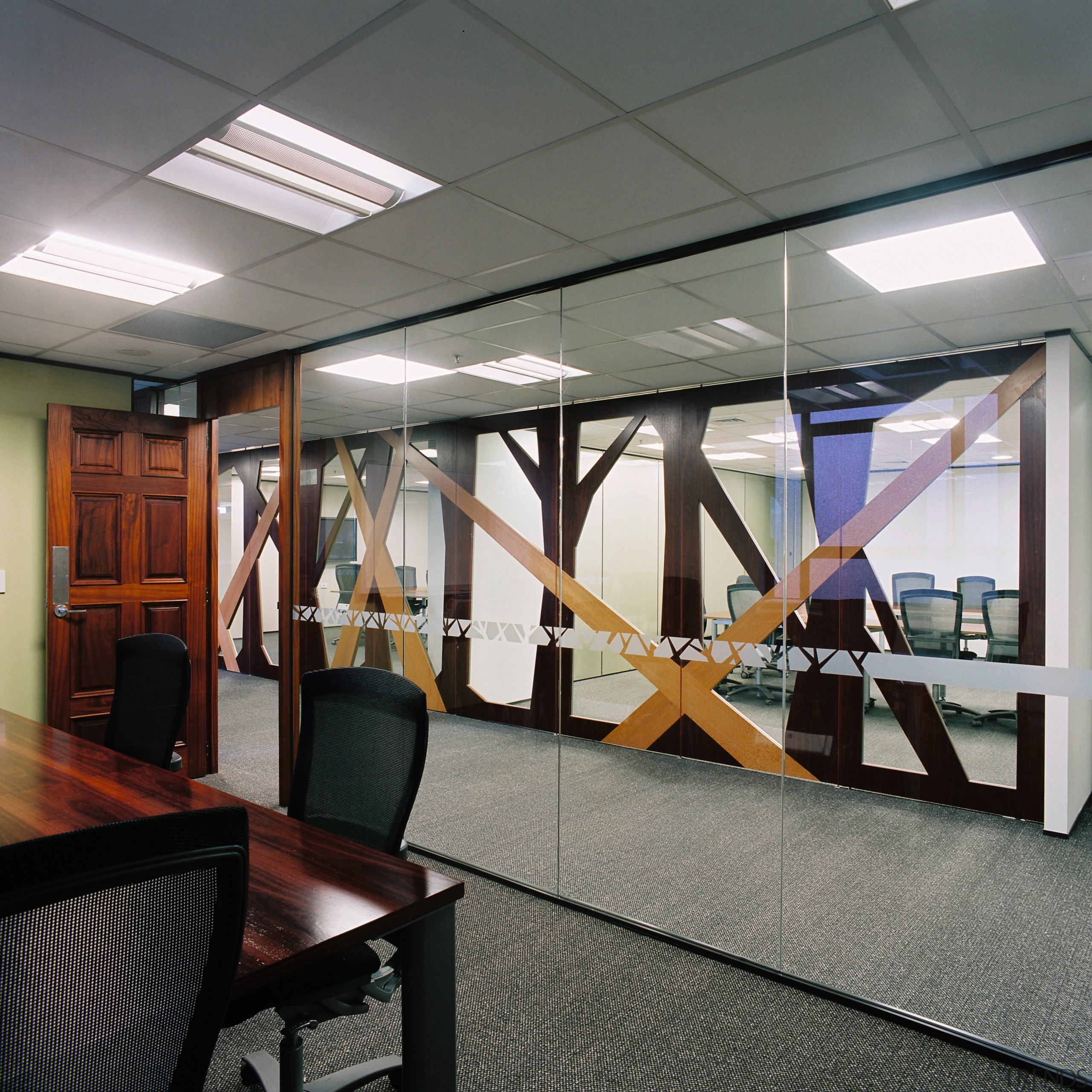 A view of the formal boardroom featuring wood ceiling, glass, institution, interior design, structure, gray, black