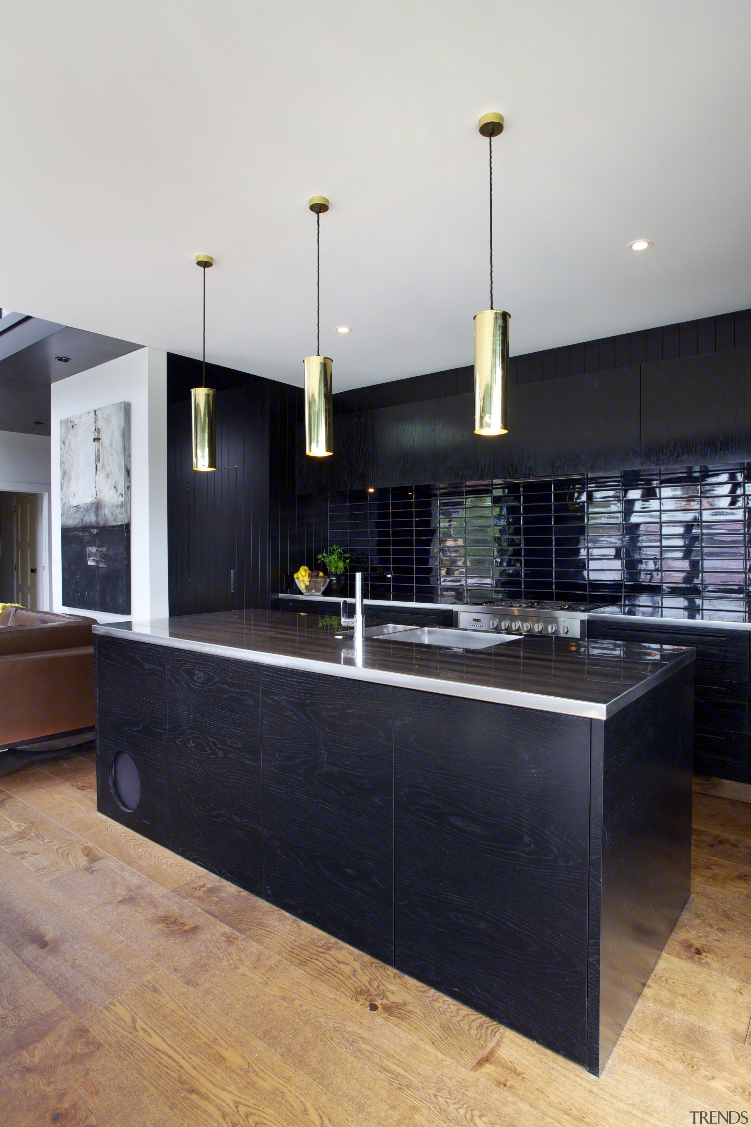In this black kitchen there are three brass architecture, countertop, interior design, kitchen, black, white