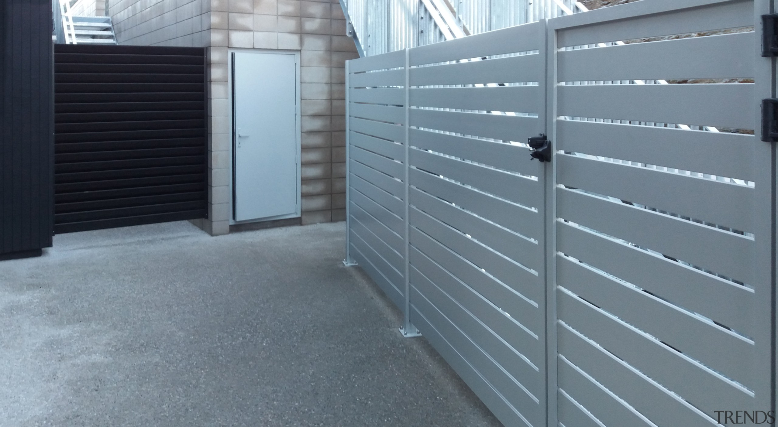 For this apartment building, HomePlus Southland custom-made all daylighting, door, facade, fence, floor, gate, siding, wall, wood, gray