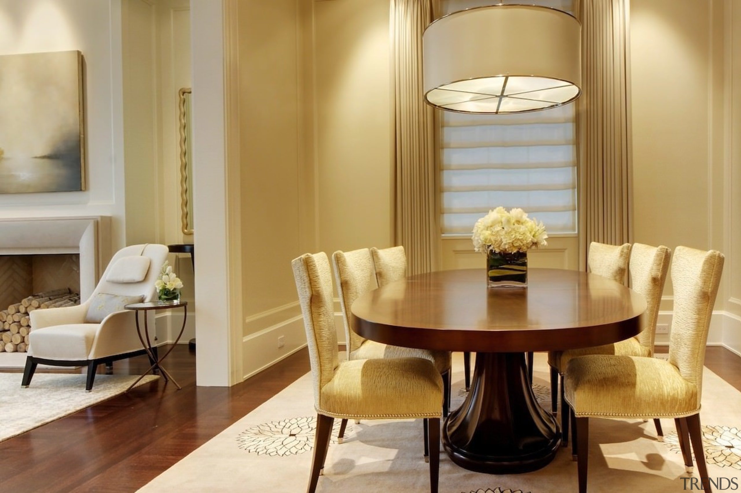 An expansive dining room opens out into the ceiling, chair, dining room, furniture, home, interior design, living room, room, suite, table, orange, brown