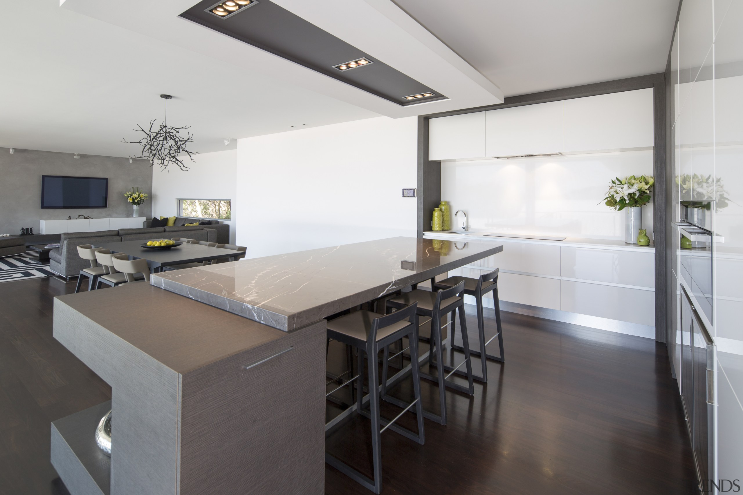 A large, rectangular bulkhead mimics the shape of countertop, floor, interior design, kitchen, real estate, white, gray