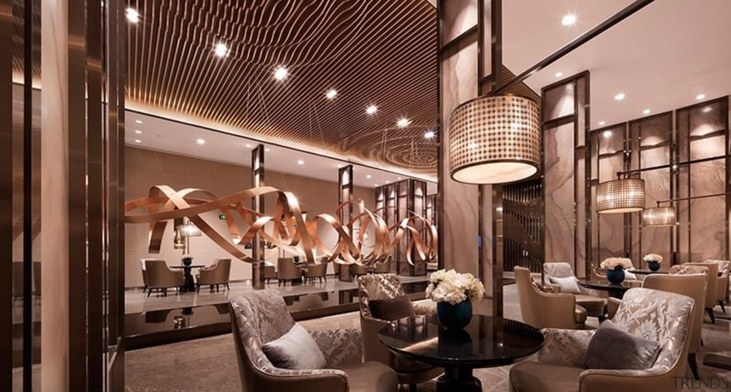 This lobby features an impressive sculpture running along interior design, lobby, brown, orange