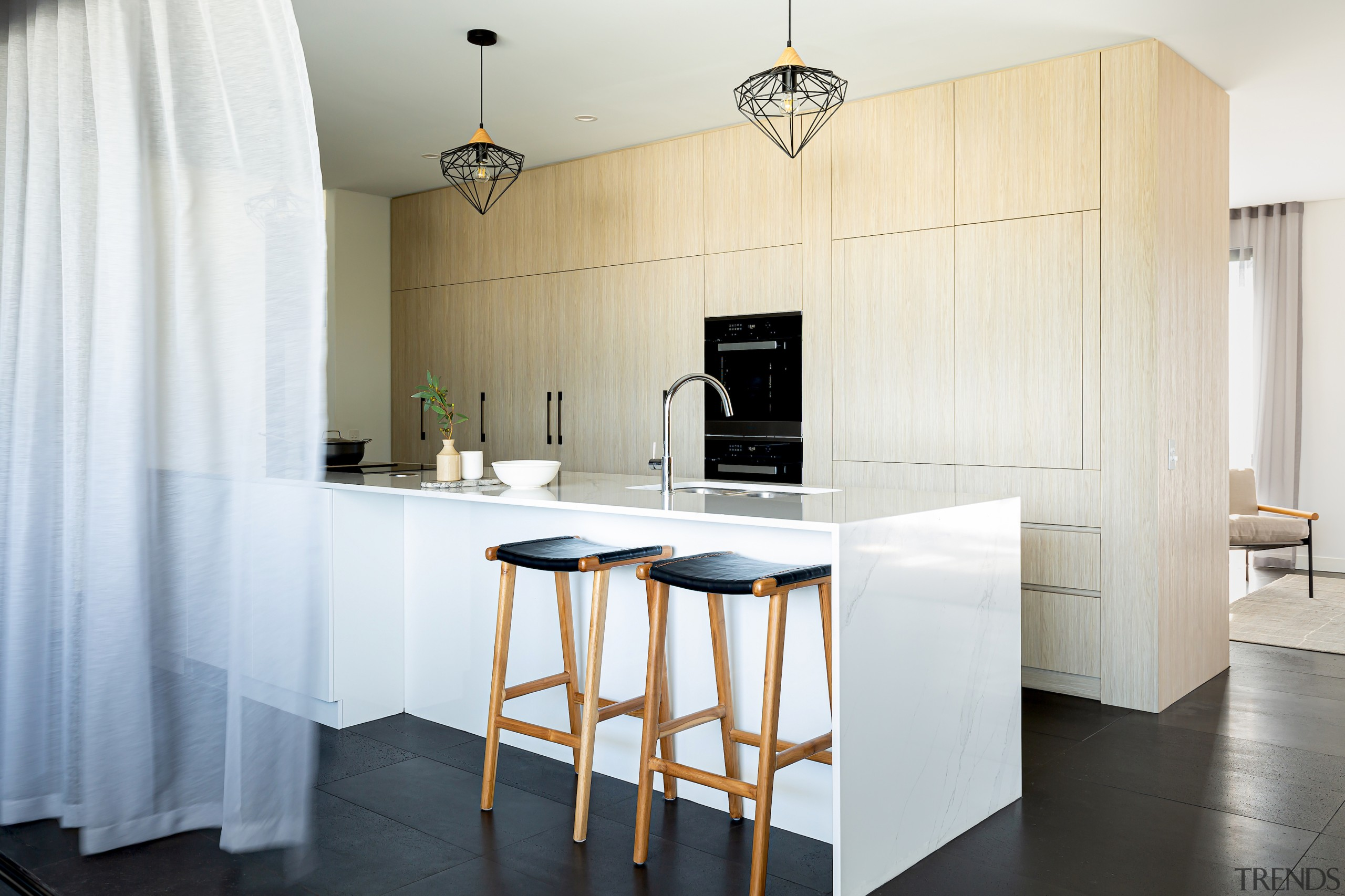 Using similar materials throughout the kitchen and the