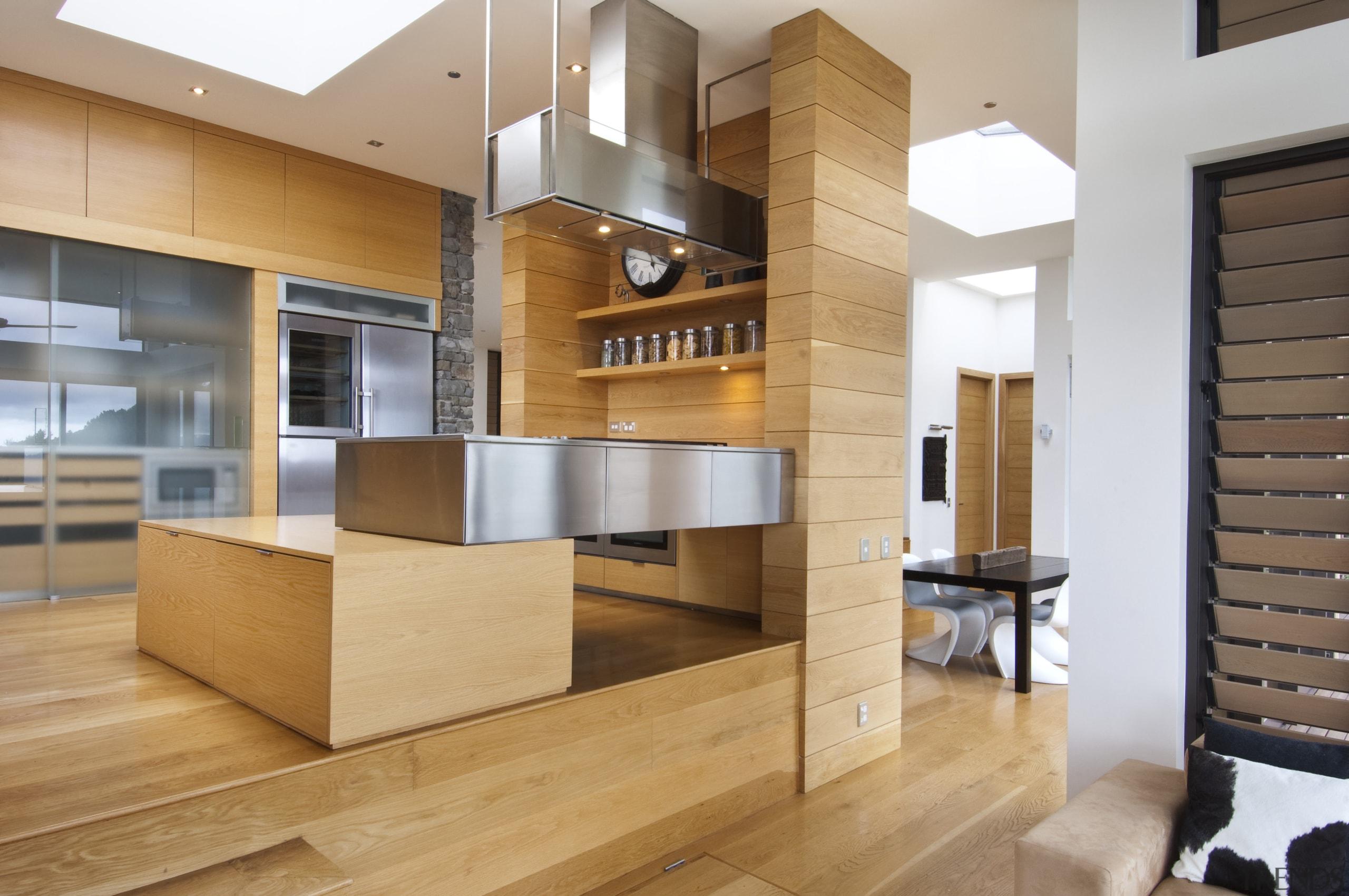 Raised floor kitchen. Stainless steel Binova cooktop. American cabinetry, countertop, cuisine classique, floor, furniture, hardwood, interior design, kitchen, wood, orange