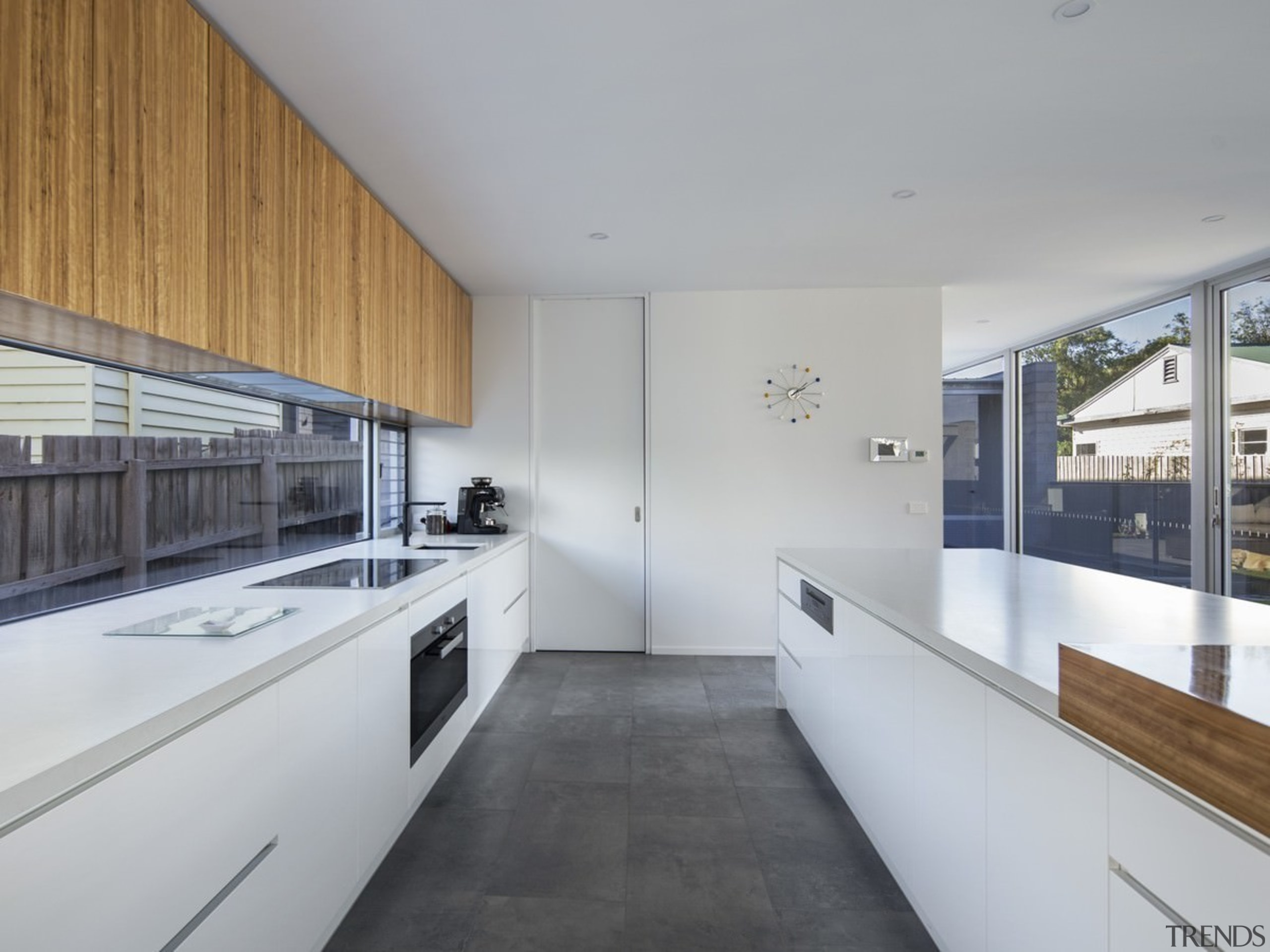 This large kitchen has a unique splashback  architecture, countertop, house, interior design, kitchen, real estate, gray