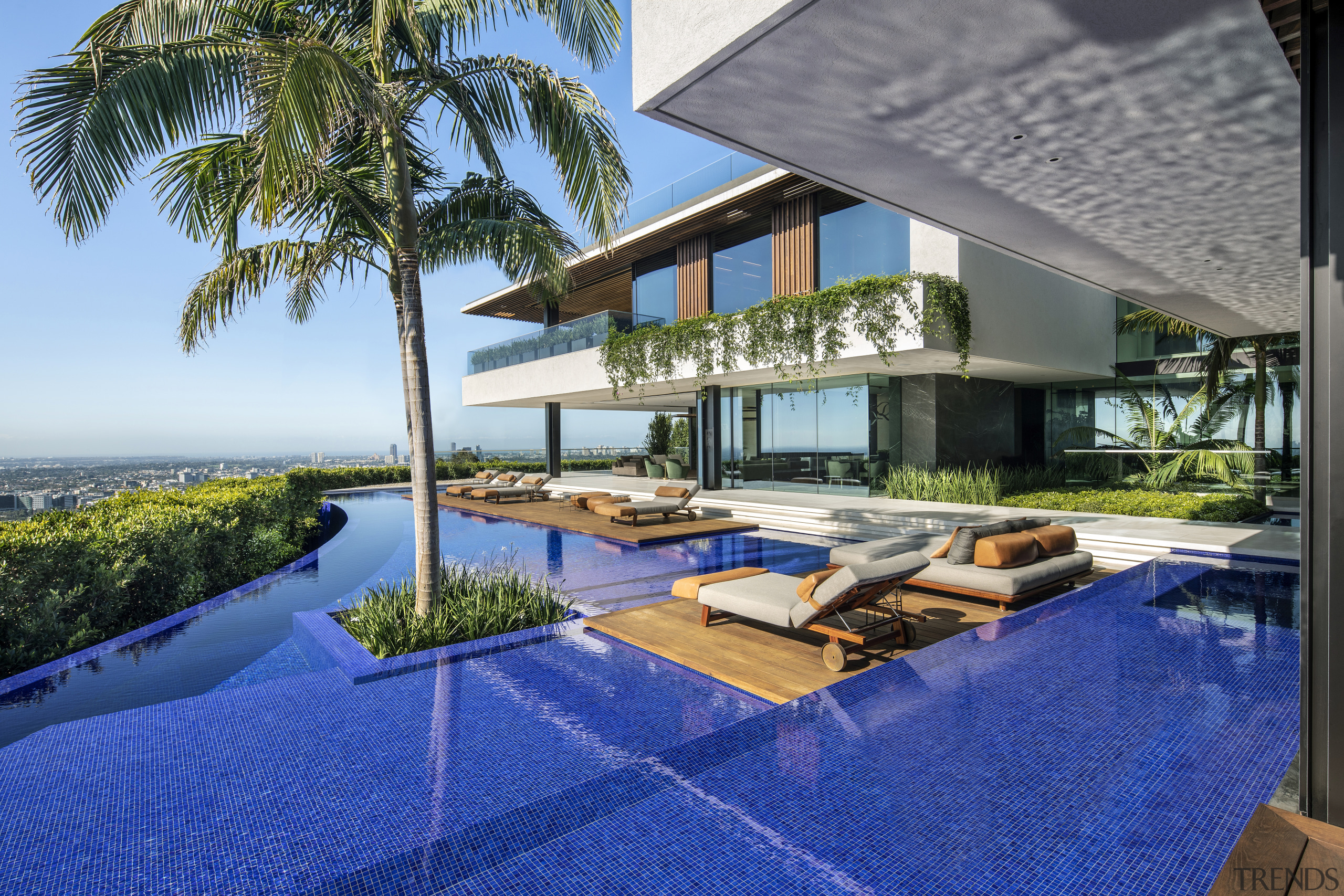 An infinity edge pool sits between the two