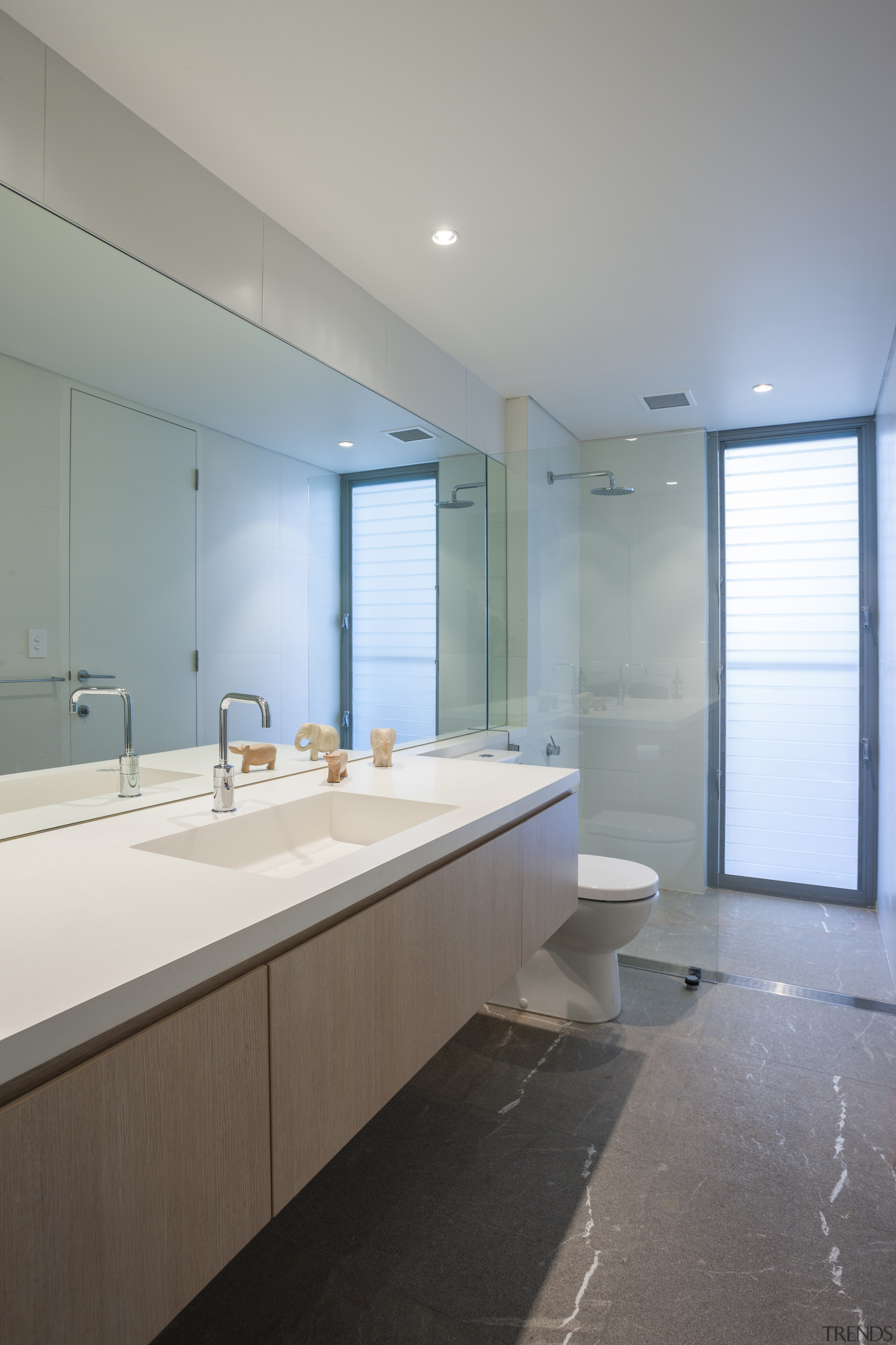Bathroom with large wall mirror. - Bathroom with architecture, bathroom, ceiling, daylighting, home, house, interior design, real estate, room, sink, gray