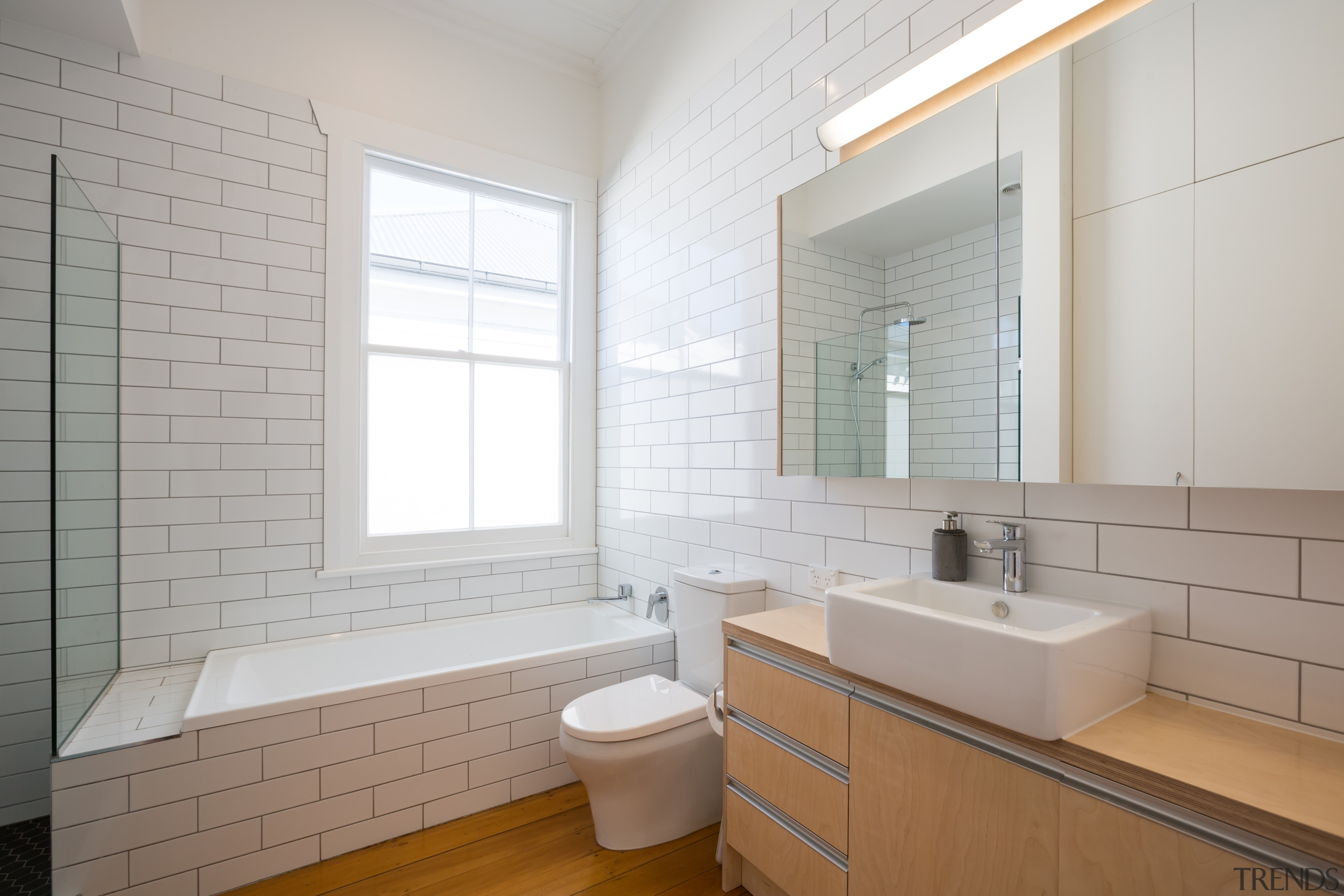 ​​​​​​​For this new bathroom in a traditional villa architecture, bathroom, timber floor, basin, subway tile, bathroomware,  Chris Holmes, CAAHT Studio Architects