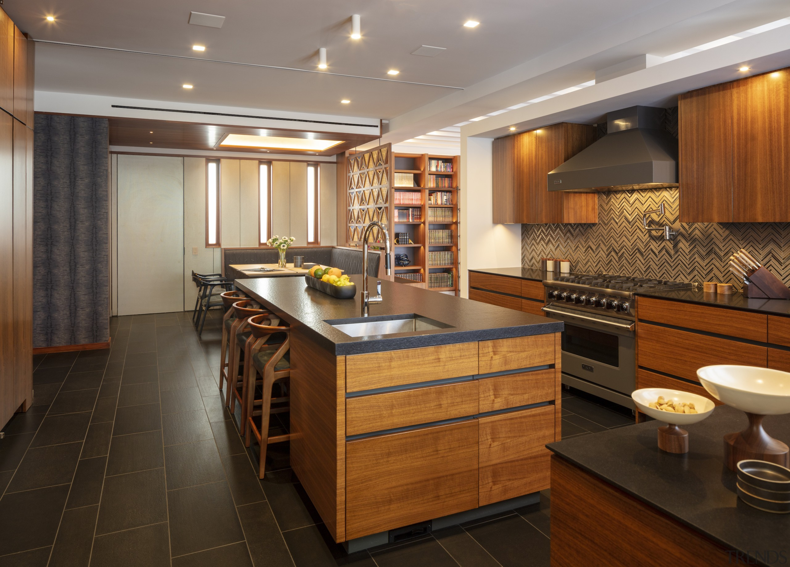 The splashback provides lively contrast within the predominantly