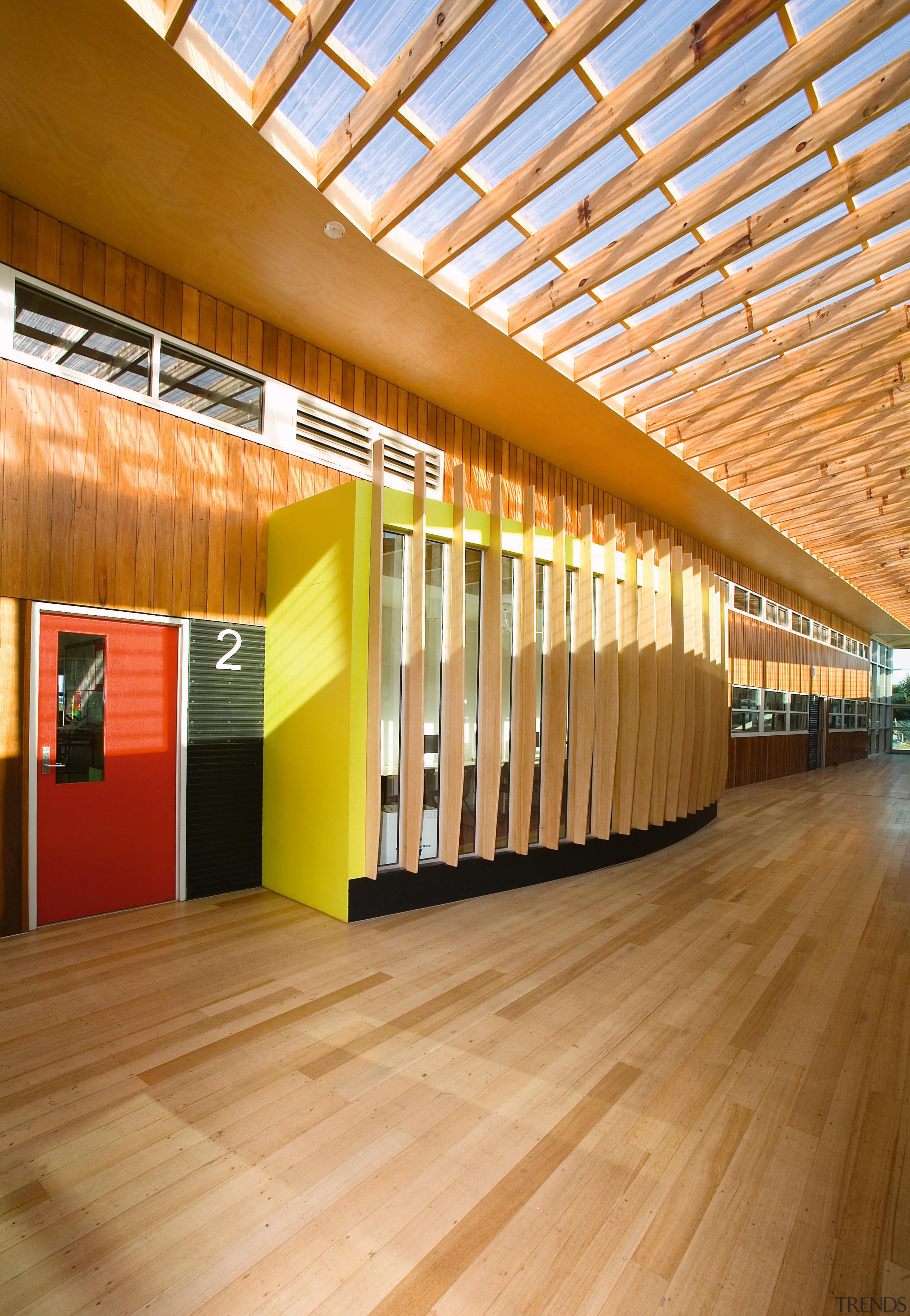 View of Williamstown High School in Melbourne. Designed architecture, ceiling, daylighting, floor, flooring, interior design, lobby, wood, orange, brown