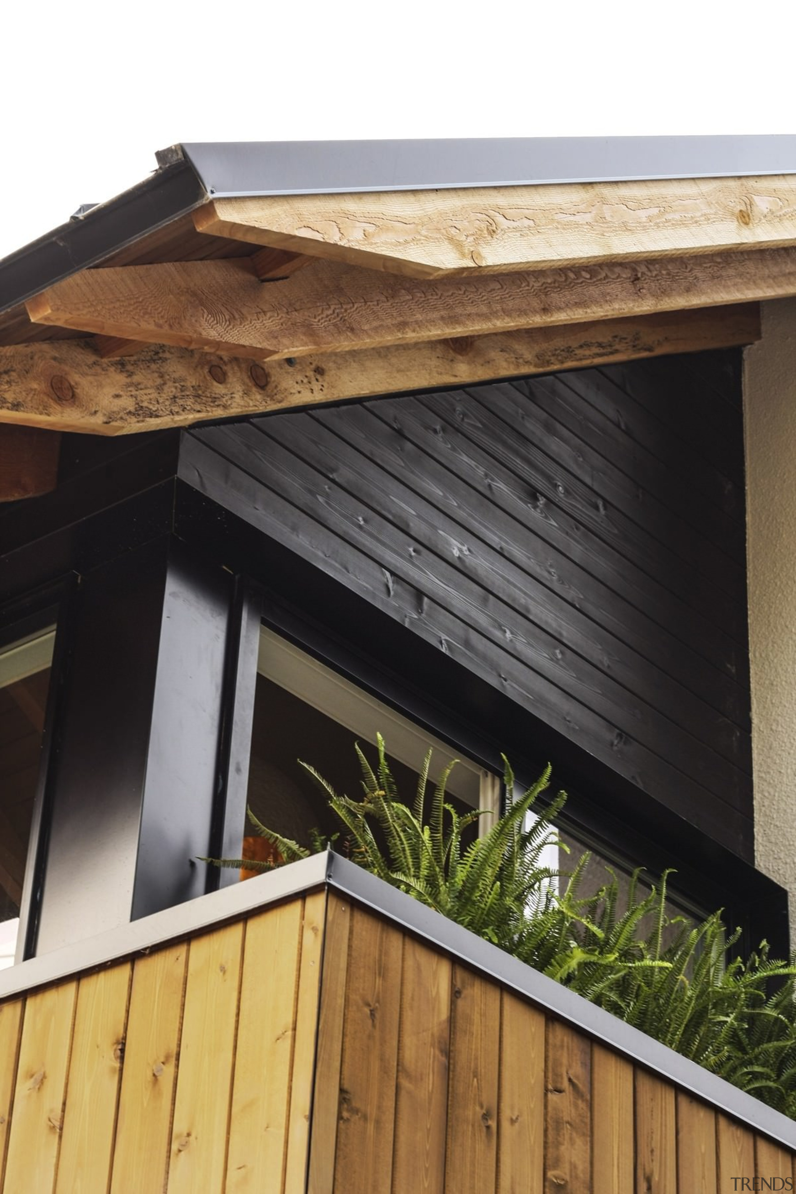 Raw timber supports add character - Raw timber daylighting, facade, house, roof, siding, wood, black