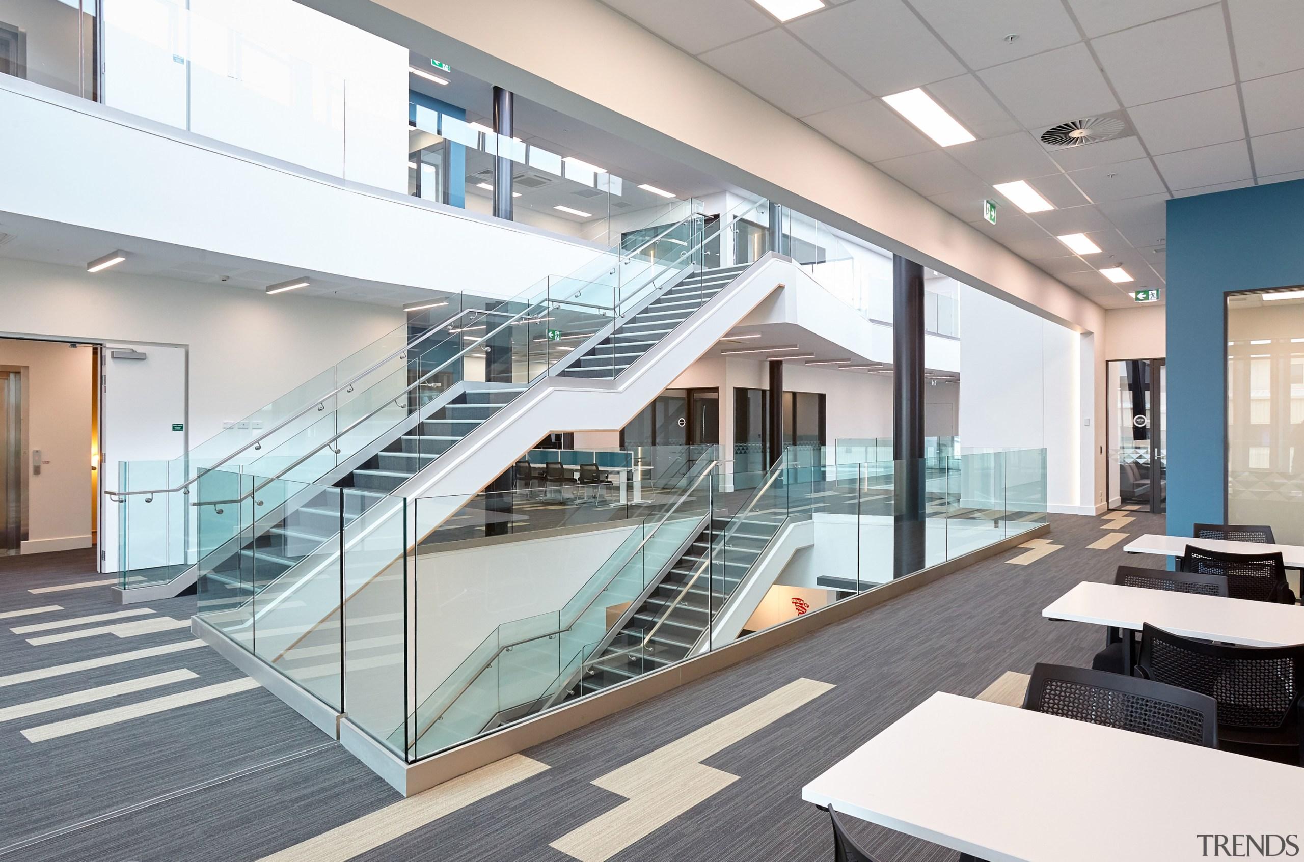 The three-storey atrium, or Learning Laneway, in Te architecture, condominium, daylighting, glass, handrail, interior design, real estate, stairs, white, gray