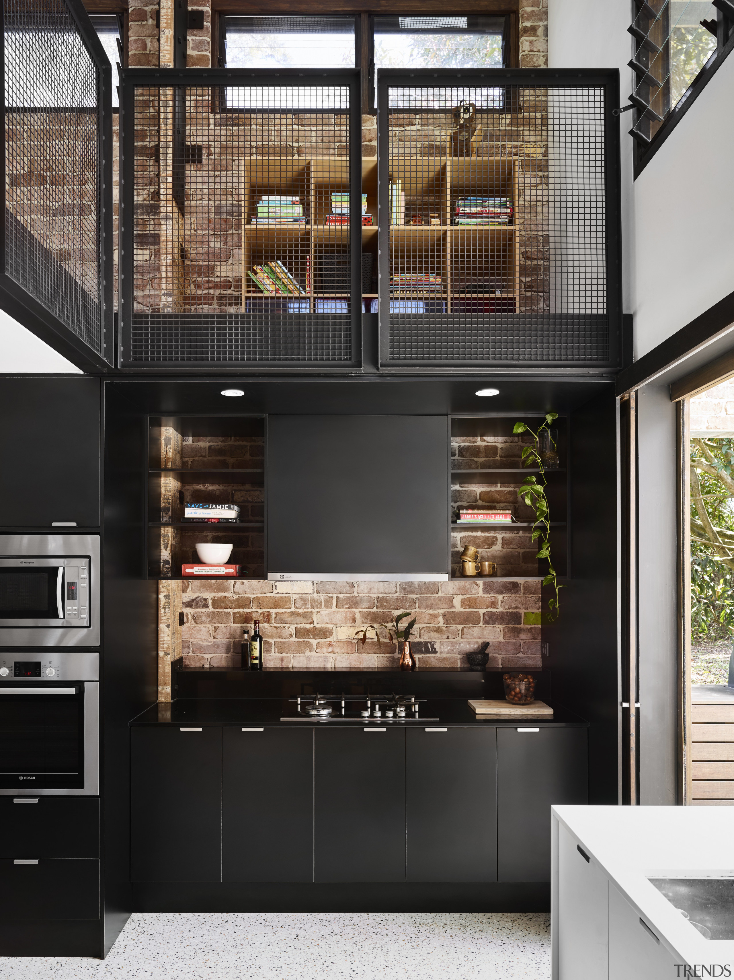 On this project by Maytree Studios, the recycled countertop, interior design, kitchen, black
