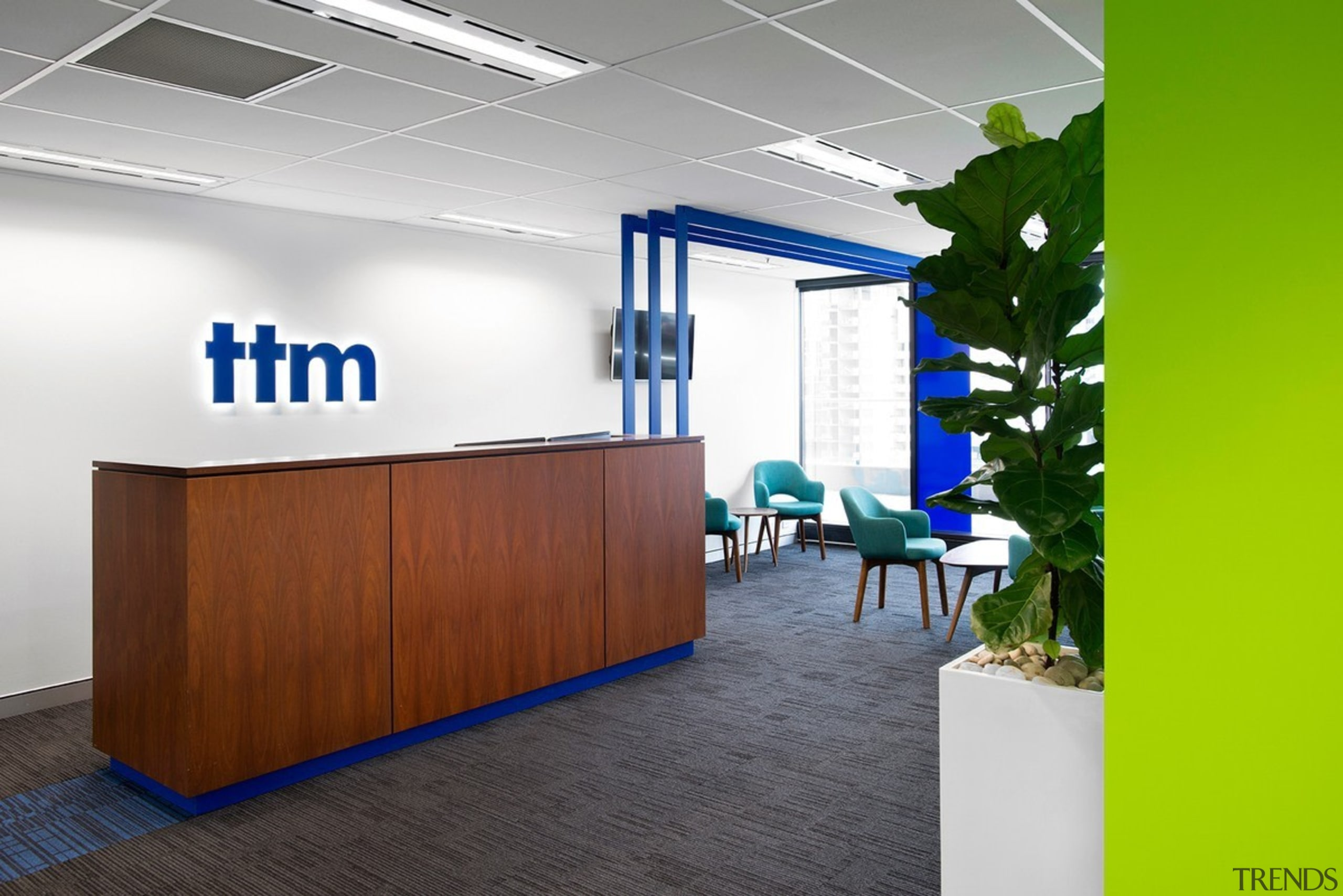 The reception desk features a simple blue logo interior design, office, product design, white