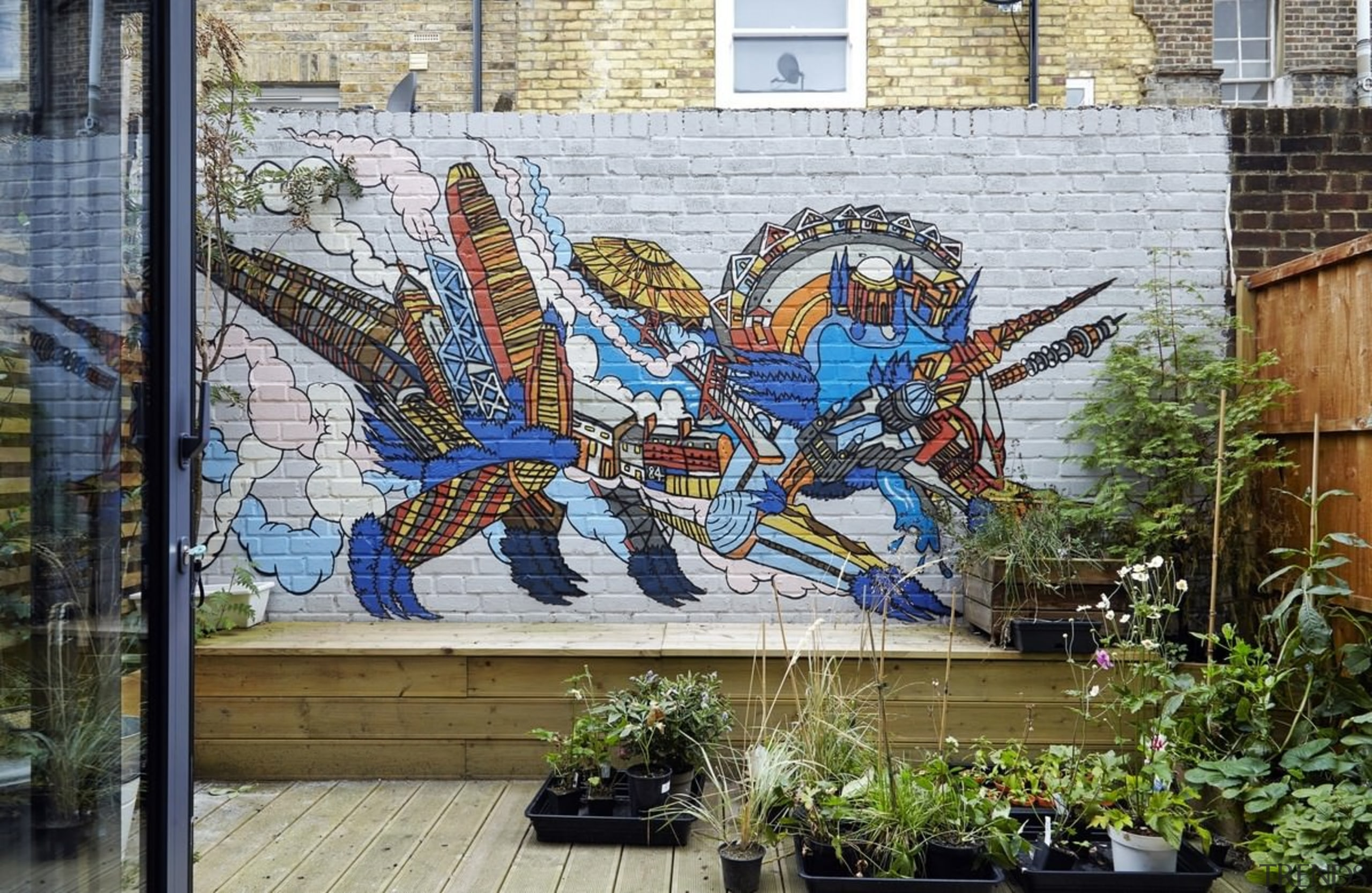 An interesting painting in the back garden draws art, graffiti, mural, street art, wall, gray
