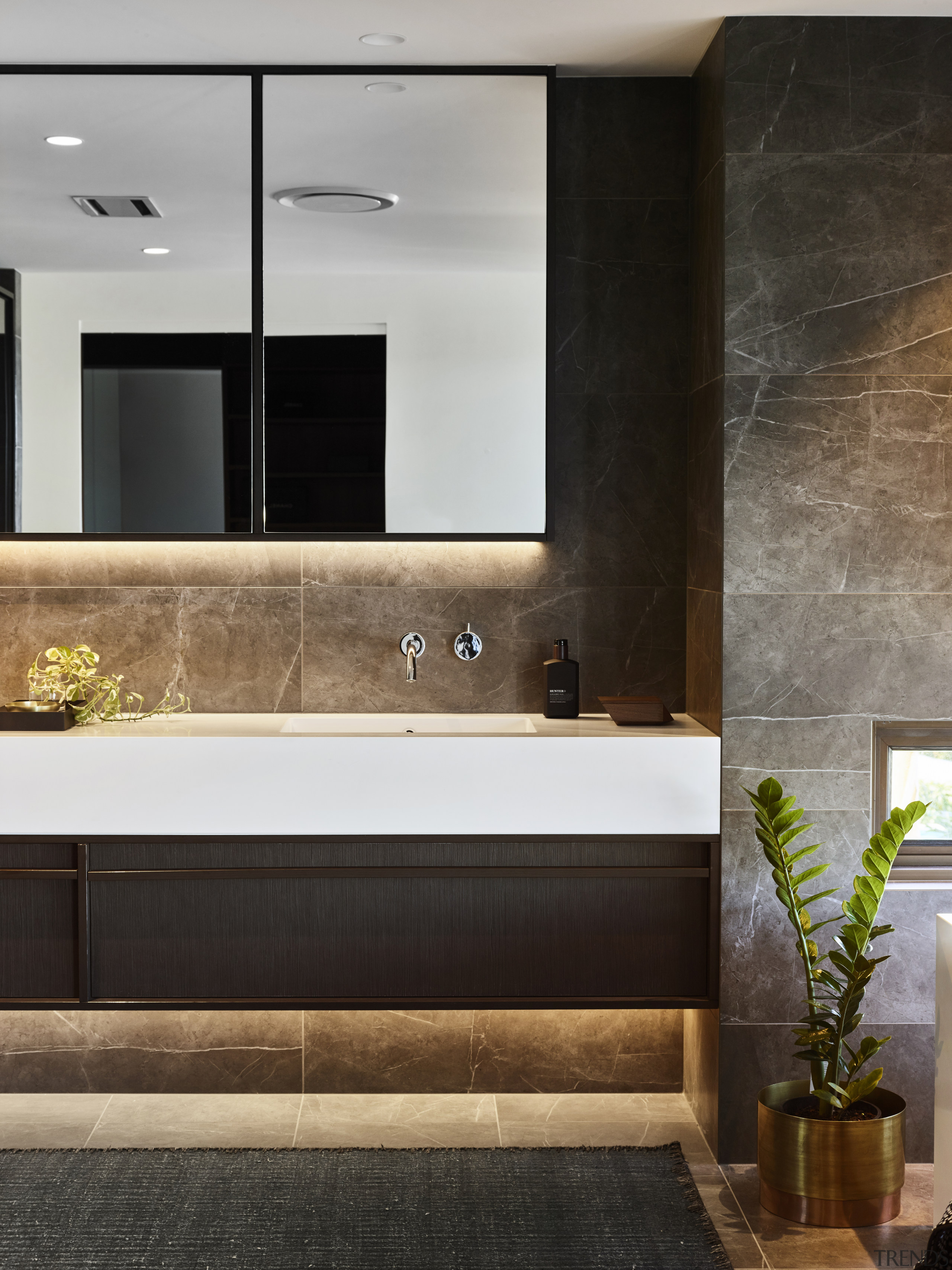 ​​​​​​​A delicate composition of tones and materials gives architecture, bathroom, bathroom accessory, building, cabinetry, ceiling, countertop, floor, flooring, furniture, home, house, interior design, marble, material property, plumbing fixture, property, room, sink, tap, tile, wall, black, gray