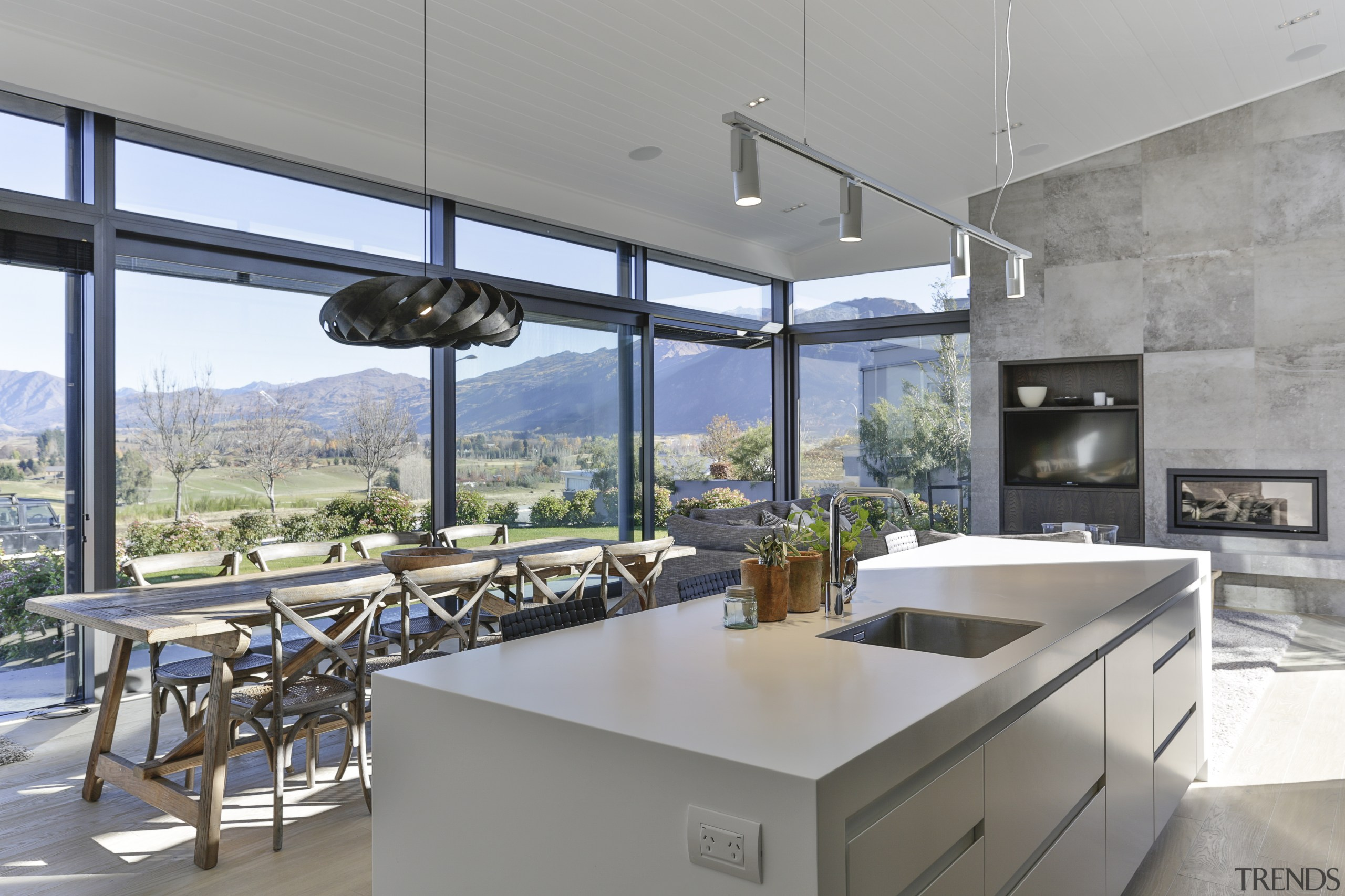 This home makes the absolute most of its apartment, architecture, building, countertop, floor, flooring, furniture, picture windows, home, house, interior design, kitchen, lresidential area, Koia Architects