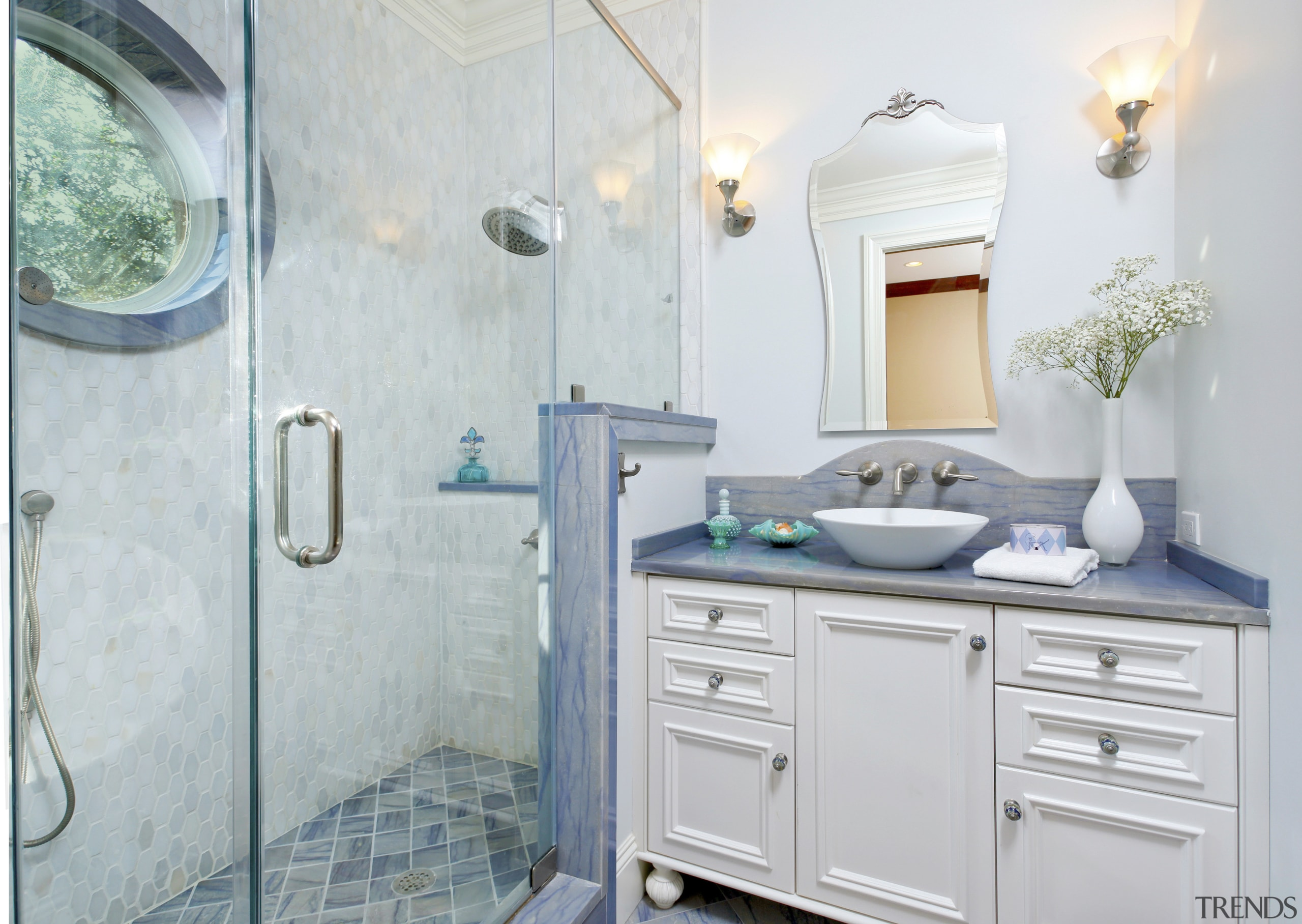 This bathroom by Cheryl Kees Clendenon manipulates color, bathroom, bathroom accessory, bathroom cabinet, countertop, home, interior design, room, sink, gray