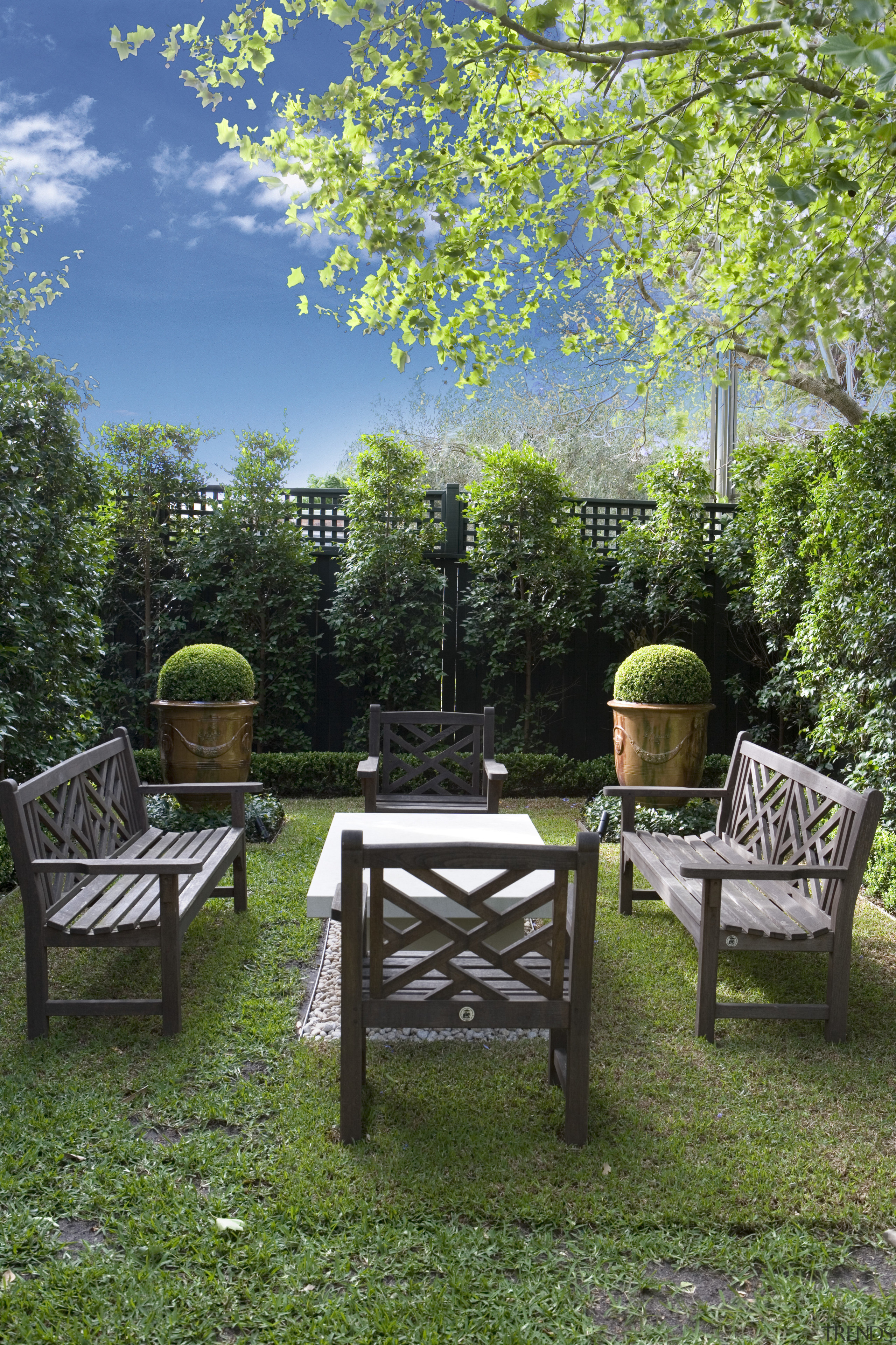 Large urns framed by low hedges and planted backyard, bench, chair, estate, furniture, garden, grass, green, home, house, landscape, landscaping, lawn, leaf, nature, outdoor structure, patio, plant, table, tree, yard, green