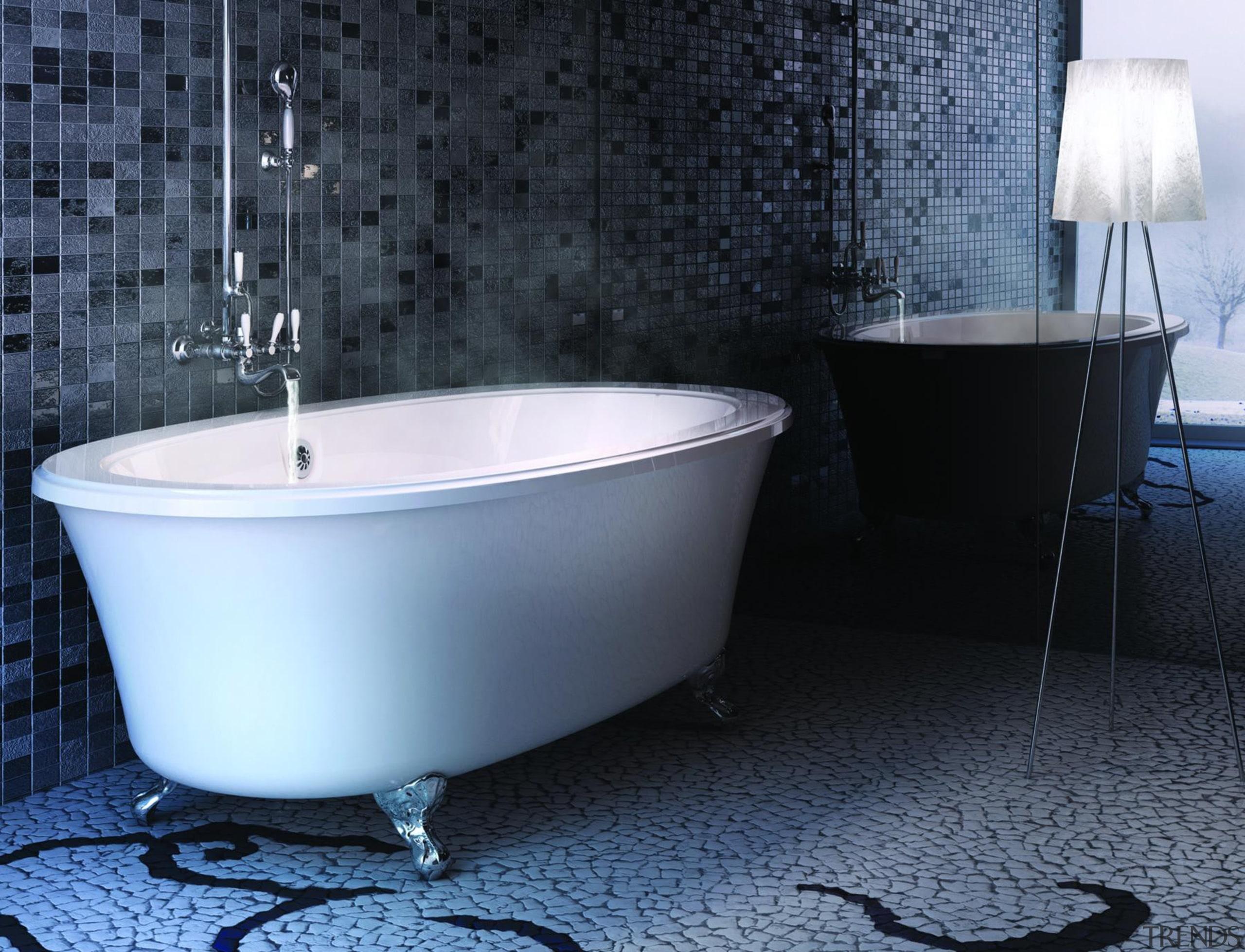 Always a classic, this claw-foot tub can be bathroom, bathtub, ceramic, floor, interior design, plumbing fixture, tap, tile, black