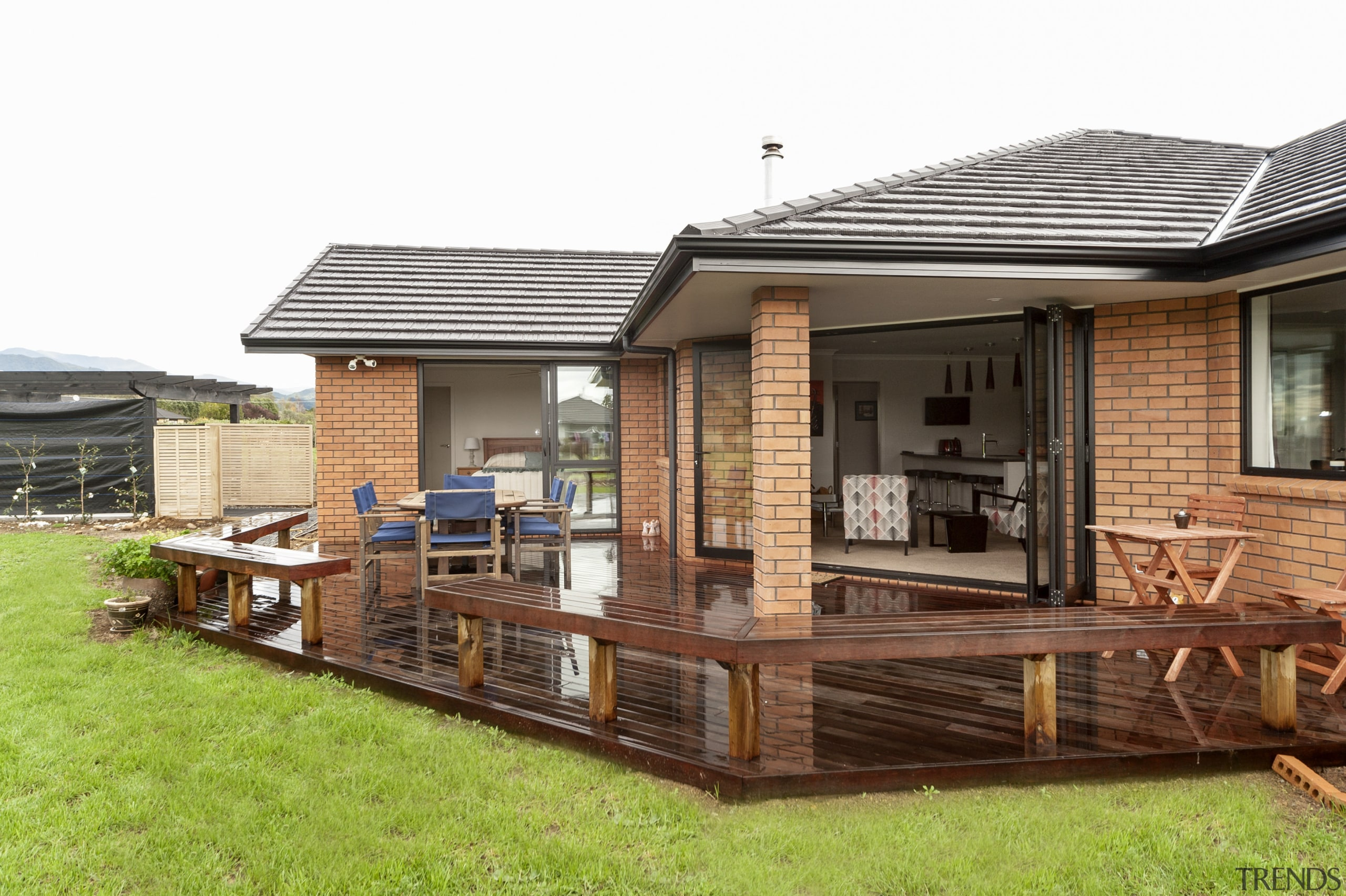 Monier Heatherstone brick and Linea weatherboards feature on backyard, cottage, deck, home, house, outdoor structure, property, real estate, roof, siding, white, brown