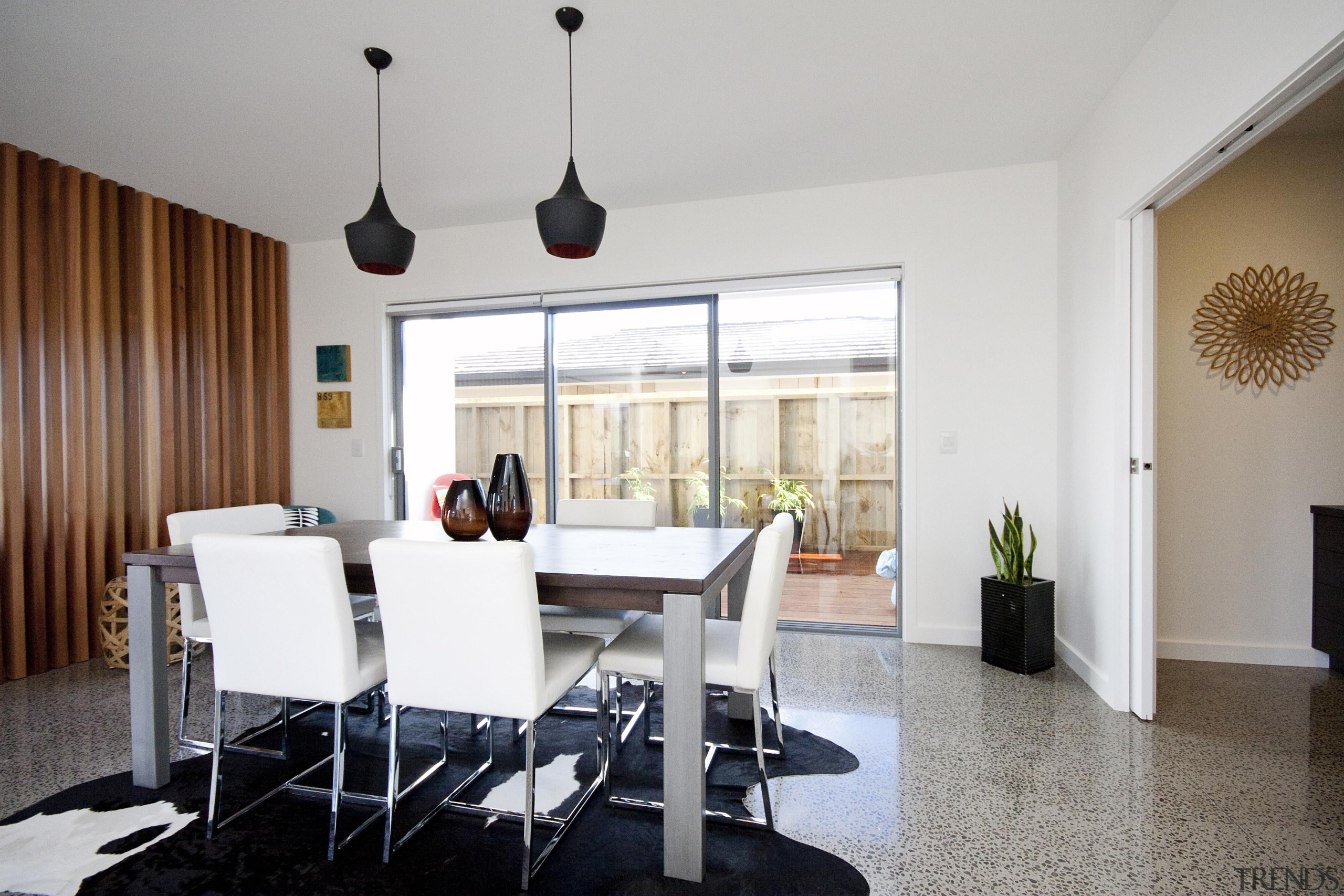 Dining room with polished concrete floor in a apartment, chair, dining room, furniture, interior design, living room, property, real estate, room, table, gray