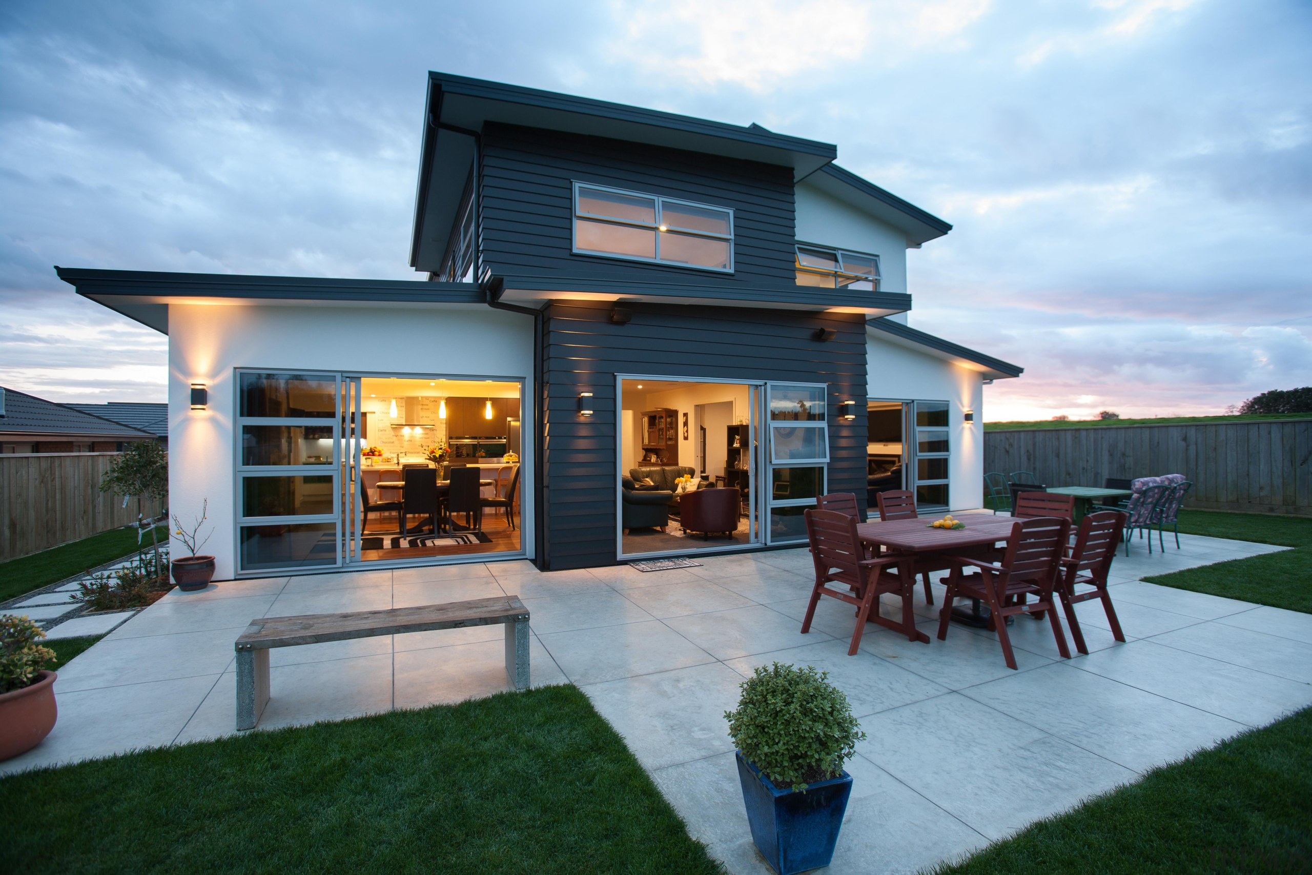 The rear view of this dual plaster and backyard, facade, home, house, property, real estate, teal