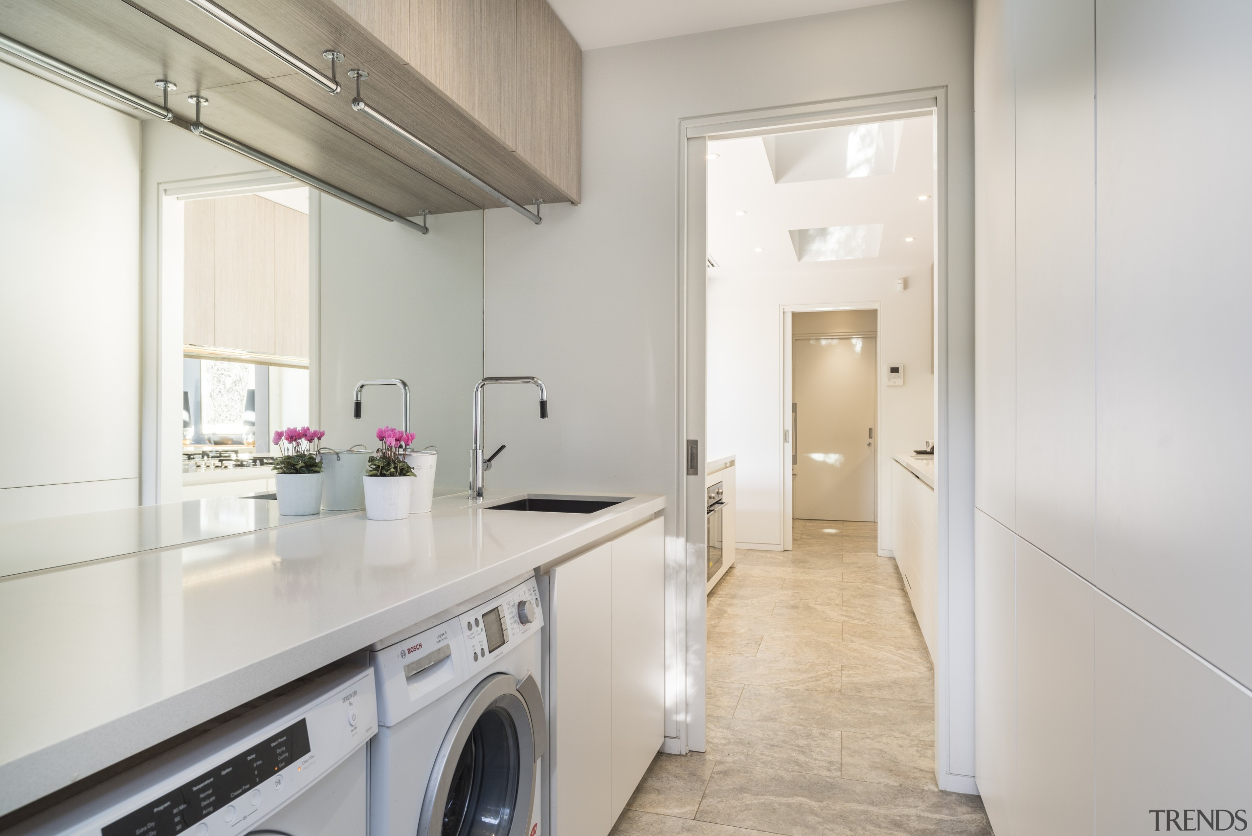The generous bench space in this laundry is countertop, cuisine classique, floor, home appliance, interior design, kitchen, property, real estate, room, gray