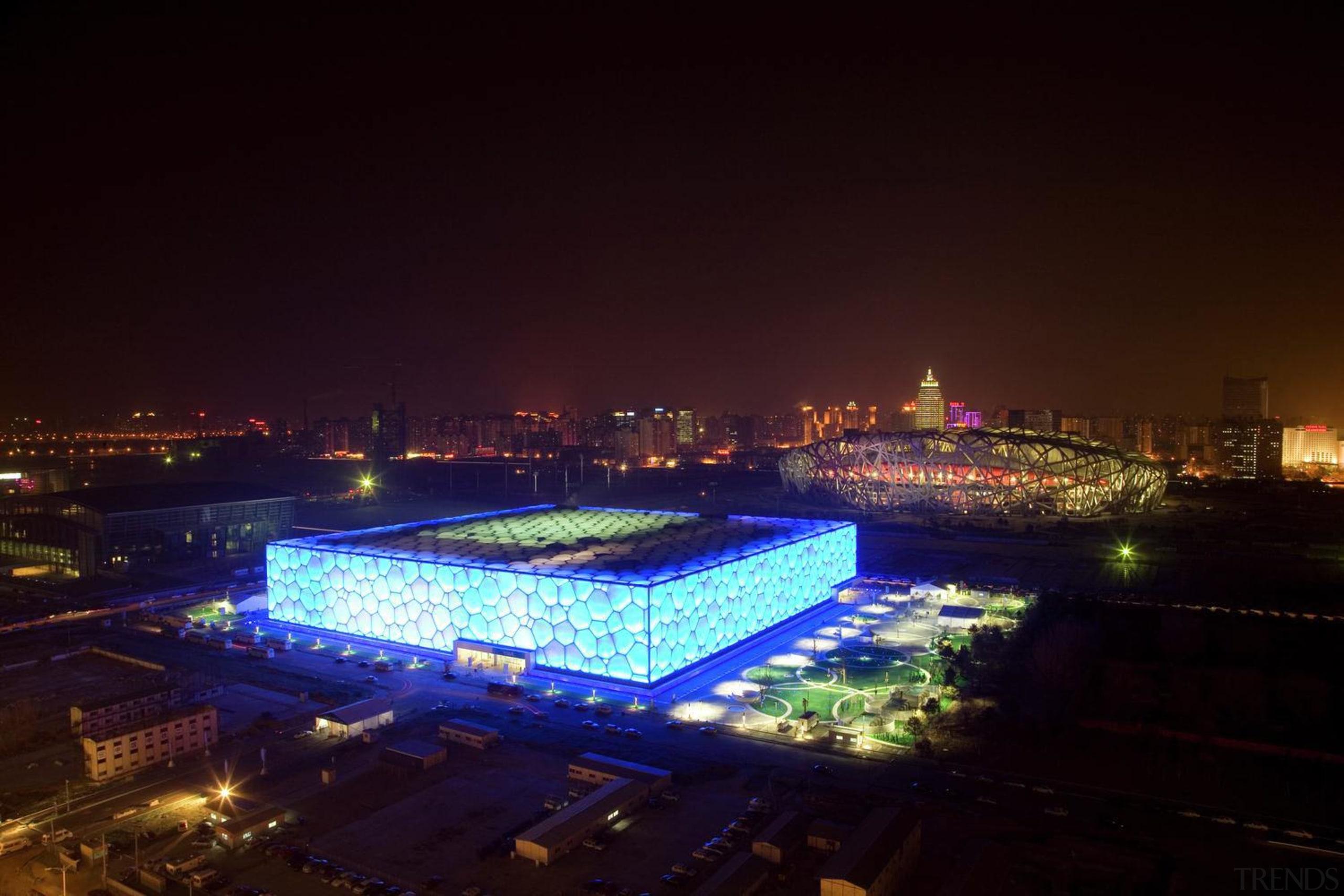The 70,000 m² National Aquatics Center in Beijing architecture, city, cityscape, downtown, landmark, metropolis, metropolitan area, night, sky, skyline, sport venue, structure, tourist attraction, urban area, black