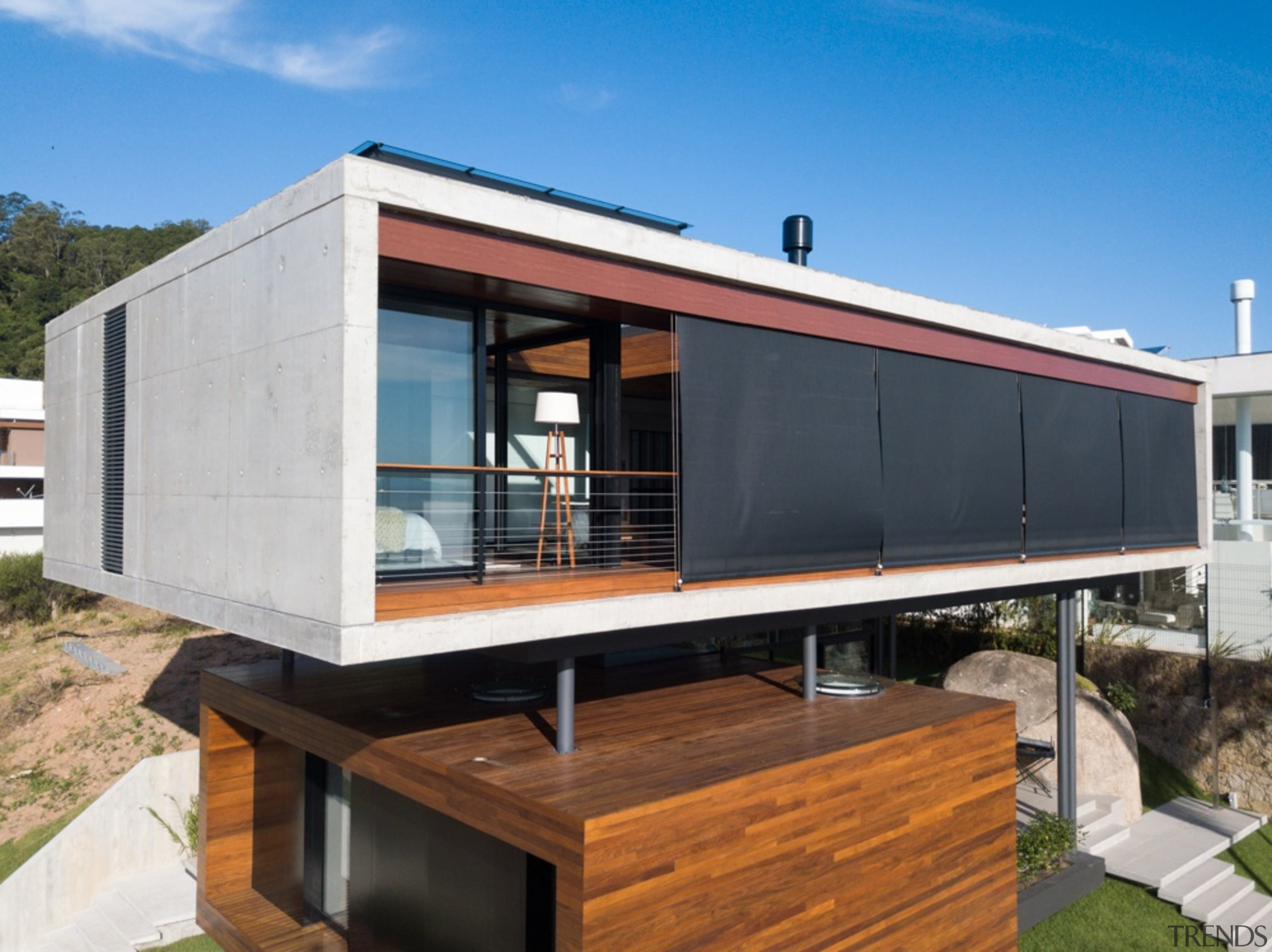 It's a home of concrete and wood volumes architecture, facade, home, house, real estate, siding, teal