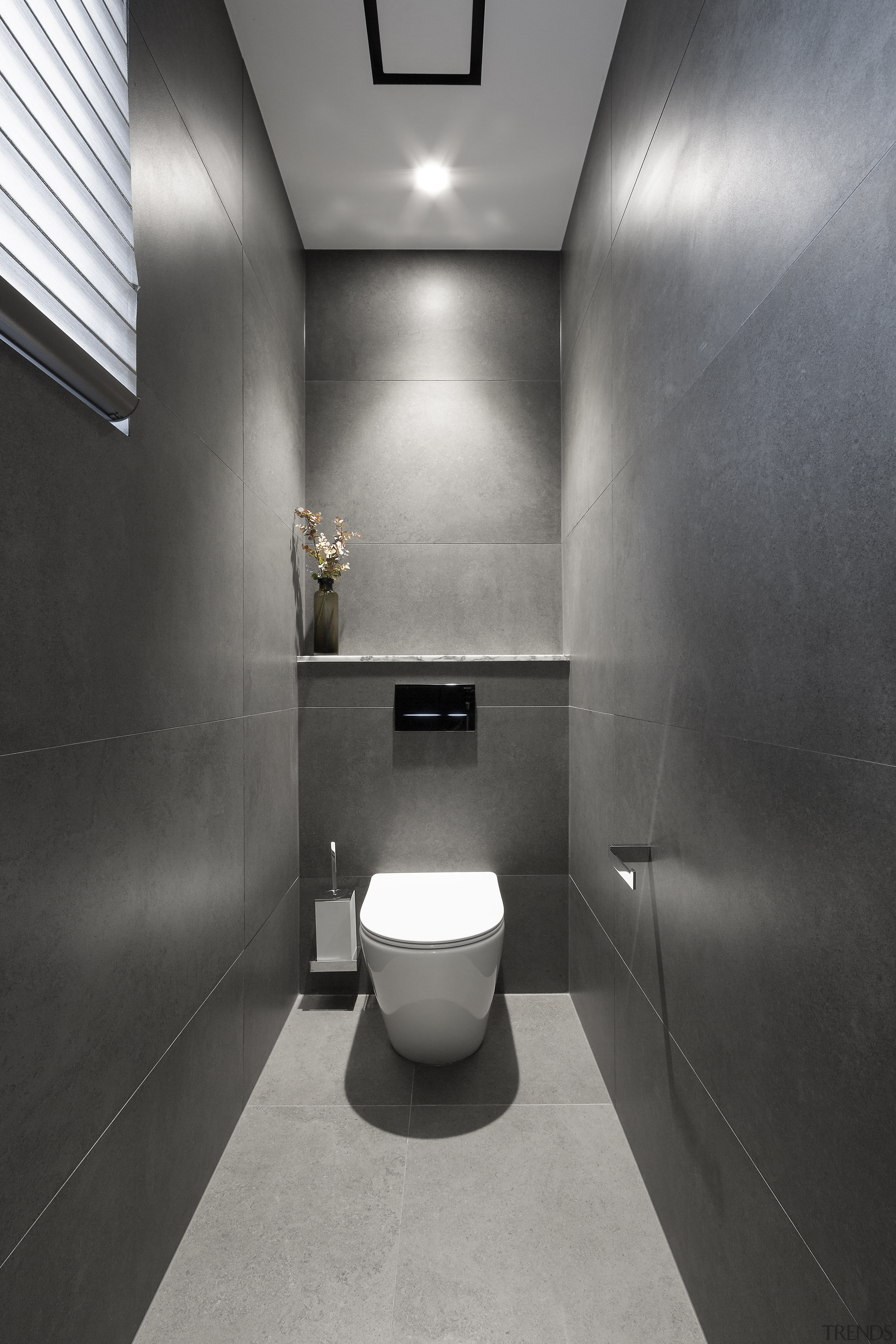 While this shower area is in predominantly grey gray, black