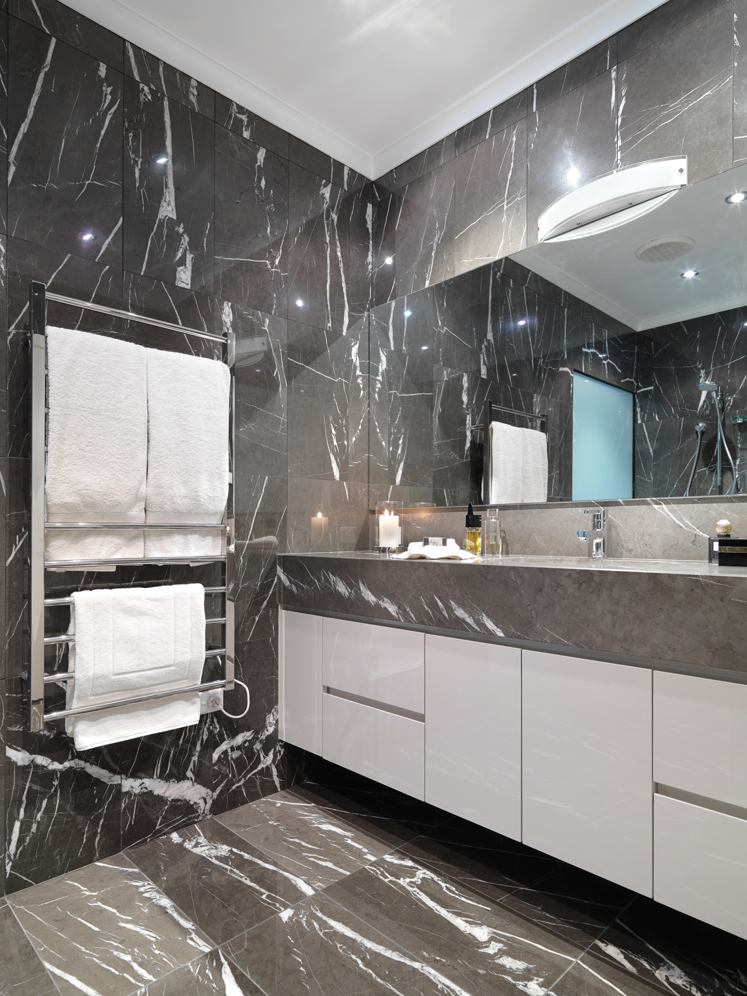 View of bathroom which features chocolate-coloured marble floor bathroom, ceiling, countertop, floor, flooring, home, interior design, kitchen, room, tile, wall, gray, black