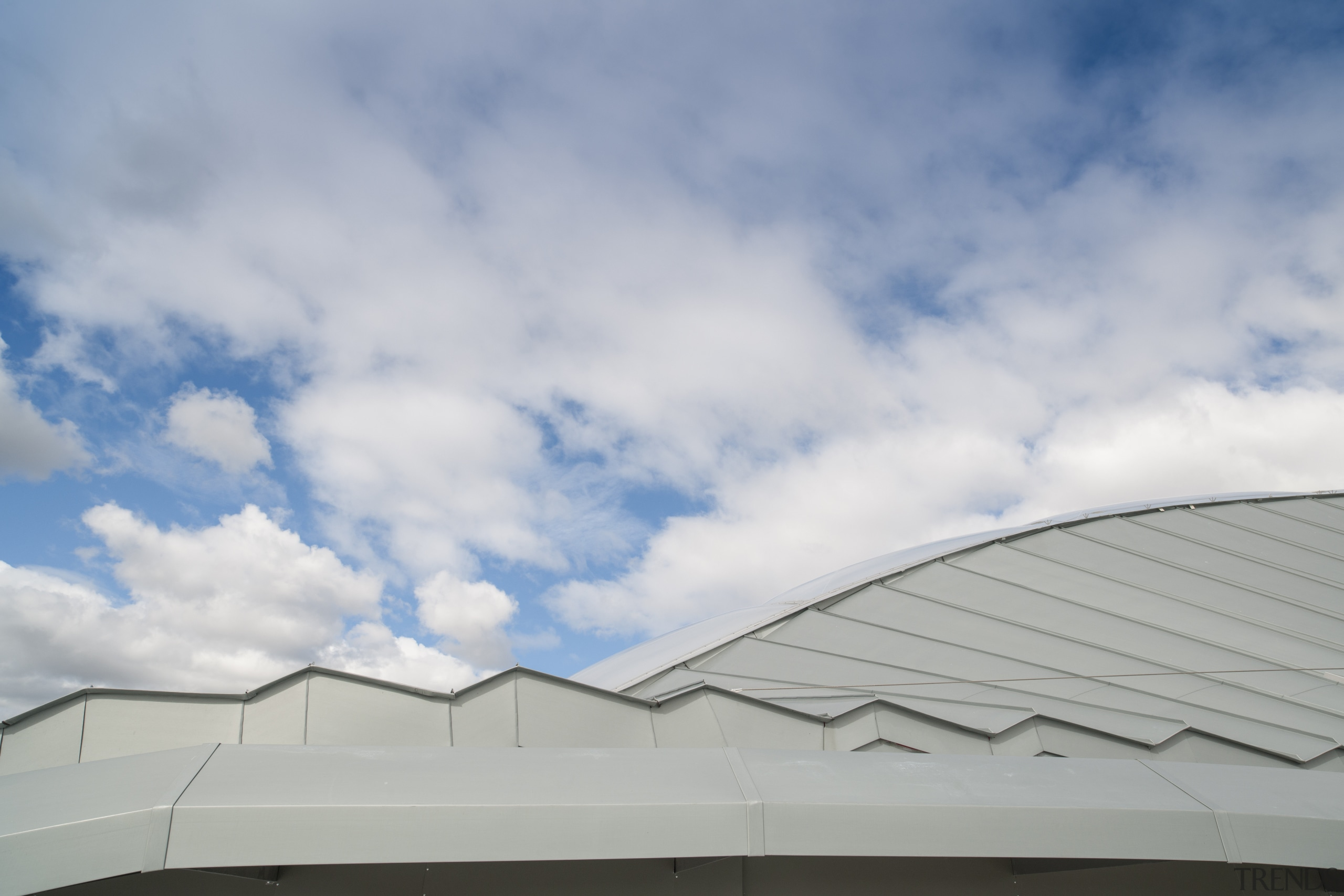 The roof was chosen in part for its angle, architecture, atmosphere of earth, building, cloud, daylighting, daytime, facade, line, meteorological phenomenon, roof, sky, structure, gray