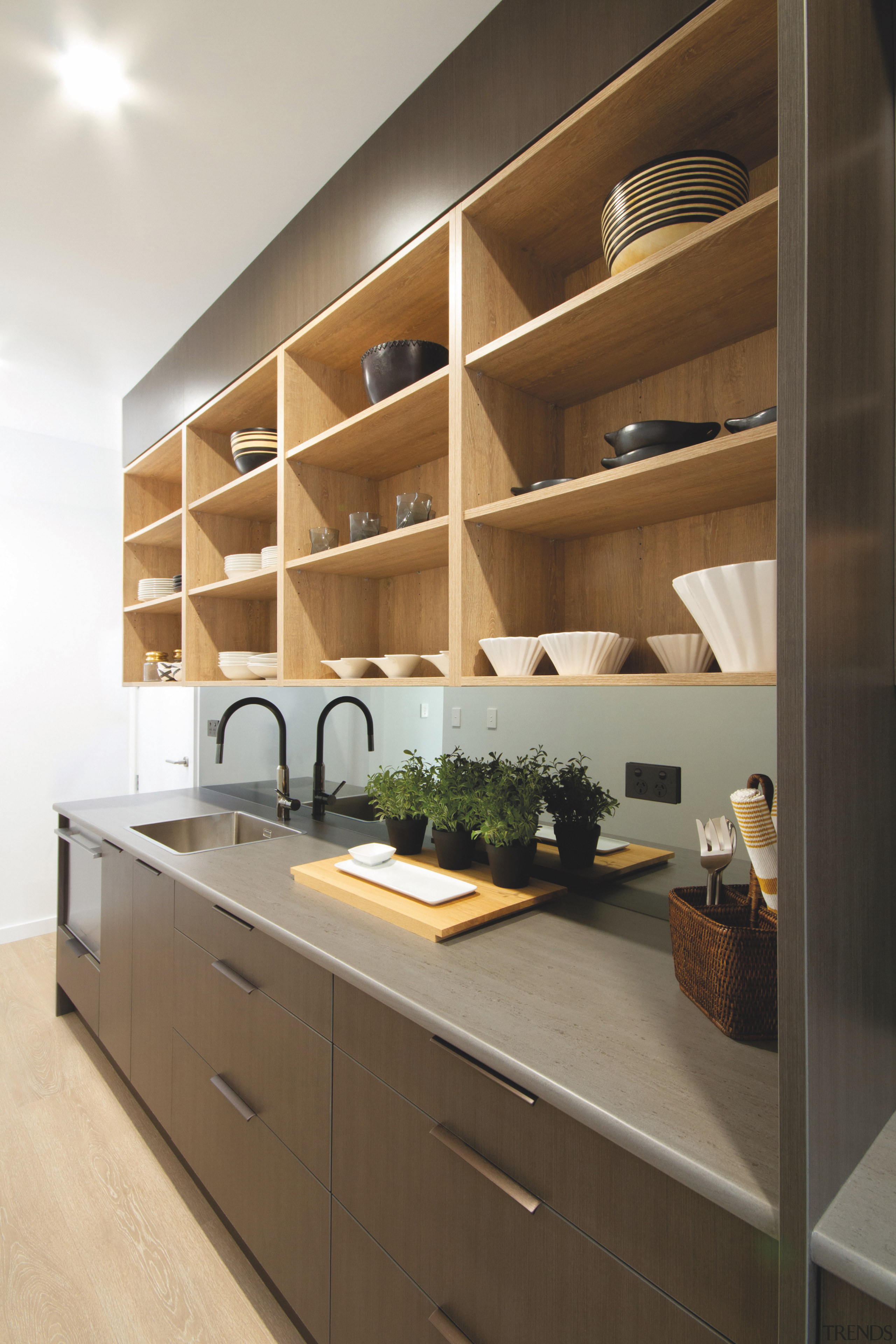 The large scullery includes feature timber display shelving.