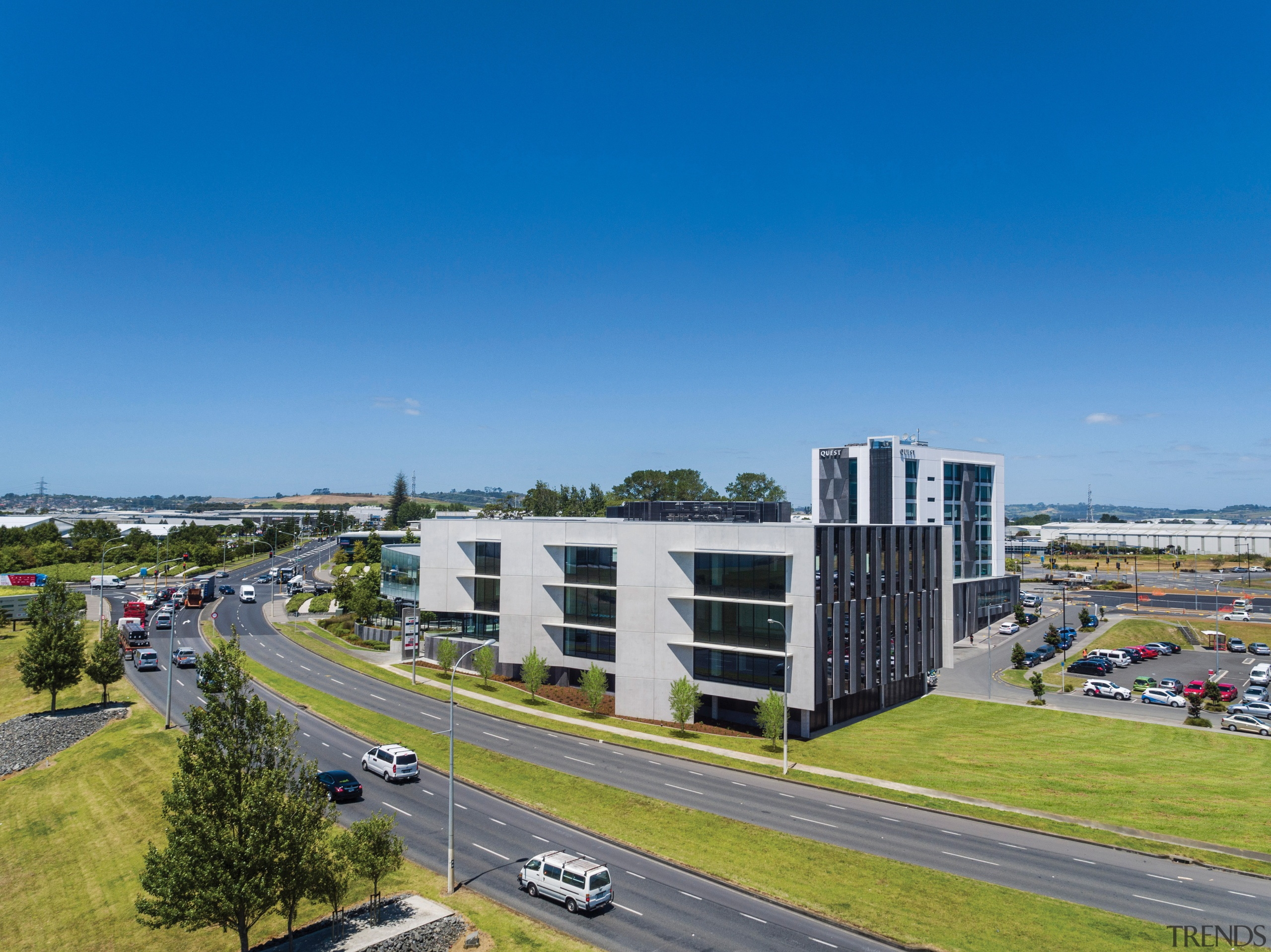 Building Five at the centrally located Highbrook Business bird's eye view, building, city, controlled access highway, corporate headquarters, daytime, highway, infrastructure, lane, metropolitan area, mixed use, real estate, residential area, road, sky, suburb, tower block, urban area, blue