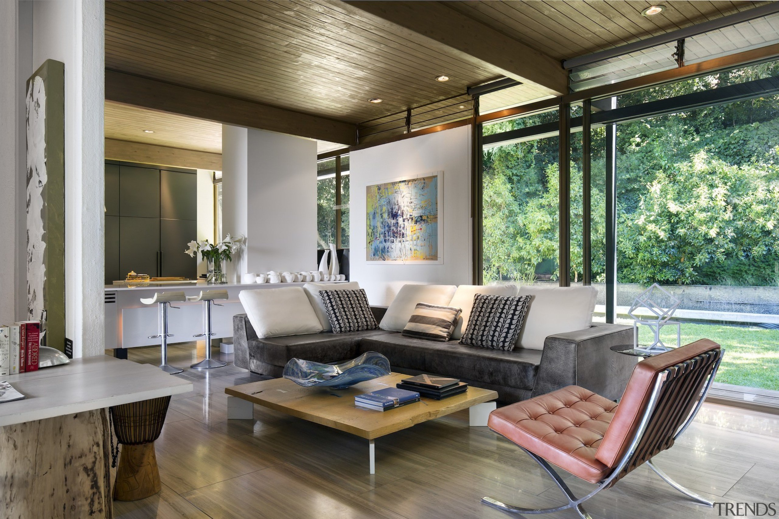 You can see elements of Phillip Johnson's 1949 house, interior design, living room, real estate, window, gray, brown