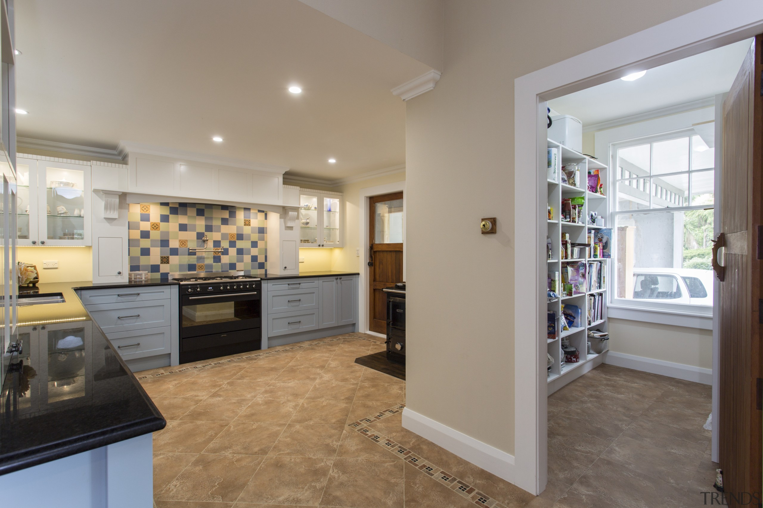 The subtle paint colours in this kitchen by floor, flooring, home, interior design, kitchen, property, real estate, room, gray