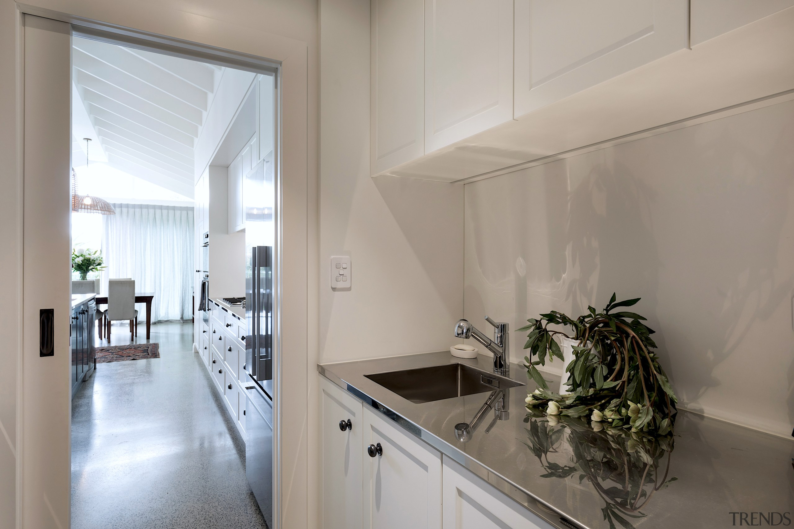 The well-appointed scullery looks out to the kitchen